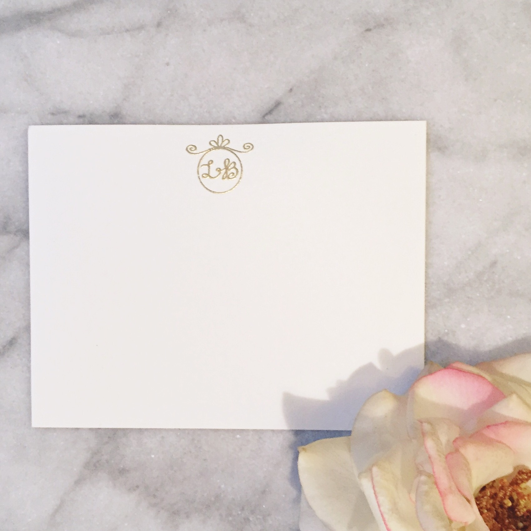 Lindsey's two letter monogrammed gold embossed stationery.