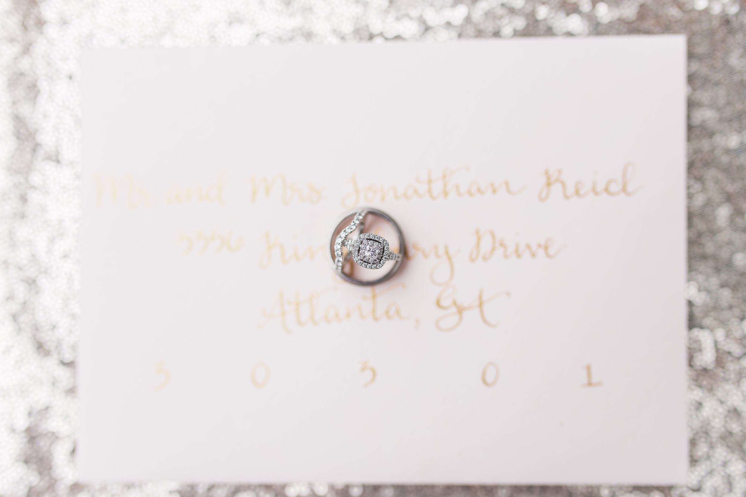 wedding envelope calligraphy with wedding rings  photo by  soul focus media