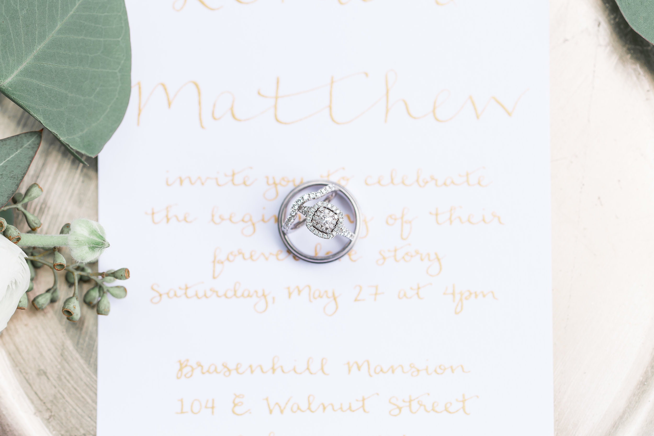 calligraphy wedding invitation with wedding rings as featured in borrowed and blue  photo by soul focus media