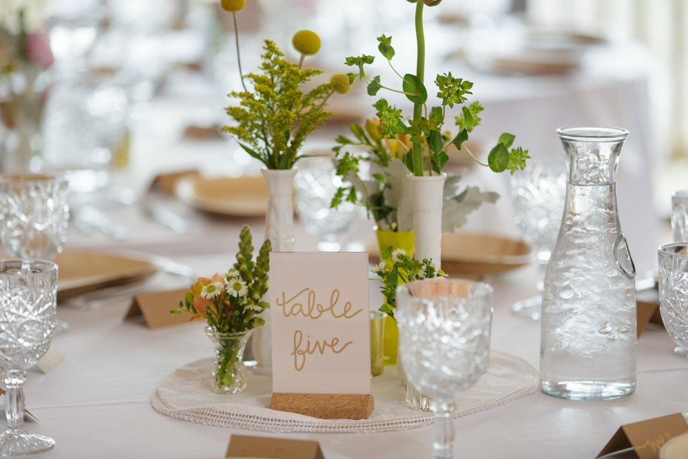 hand lettered gold wedding table numbers