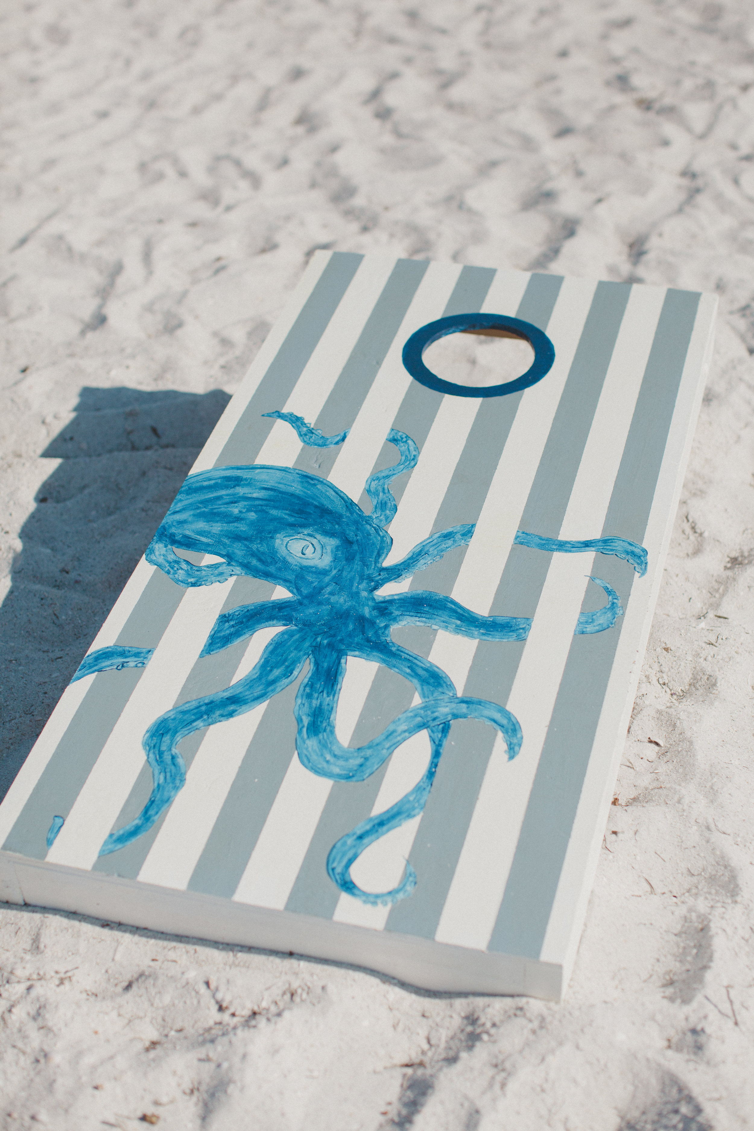 Ory comes from quite the handy family, so when we asked his dad and brother if they would build us some custom corn hole sets for the cocktail hour they were totally up for the challenge and made two different but perfectly complementary sets. And of course, one of them just had to feature the octopus :)