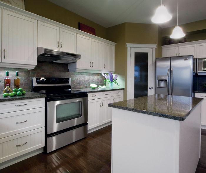 white_kitchen_cabinets_with_beadboard_doors.jpg