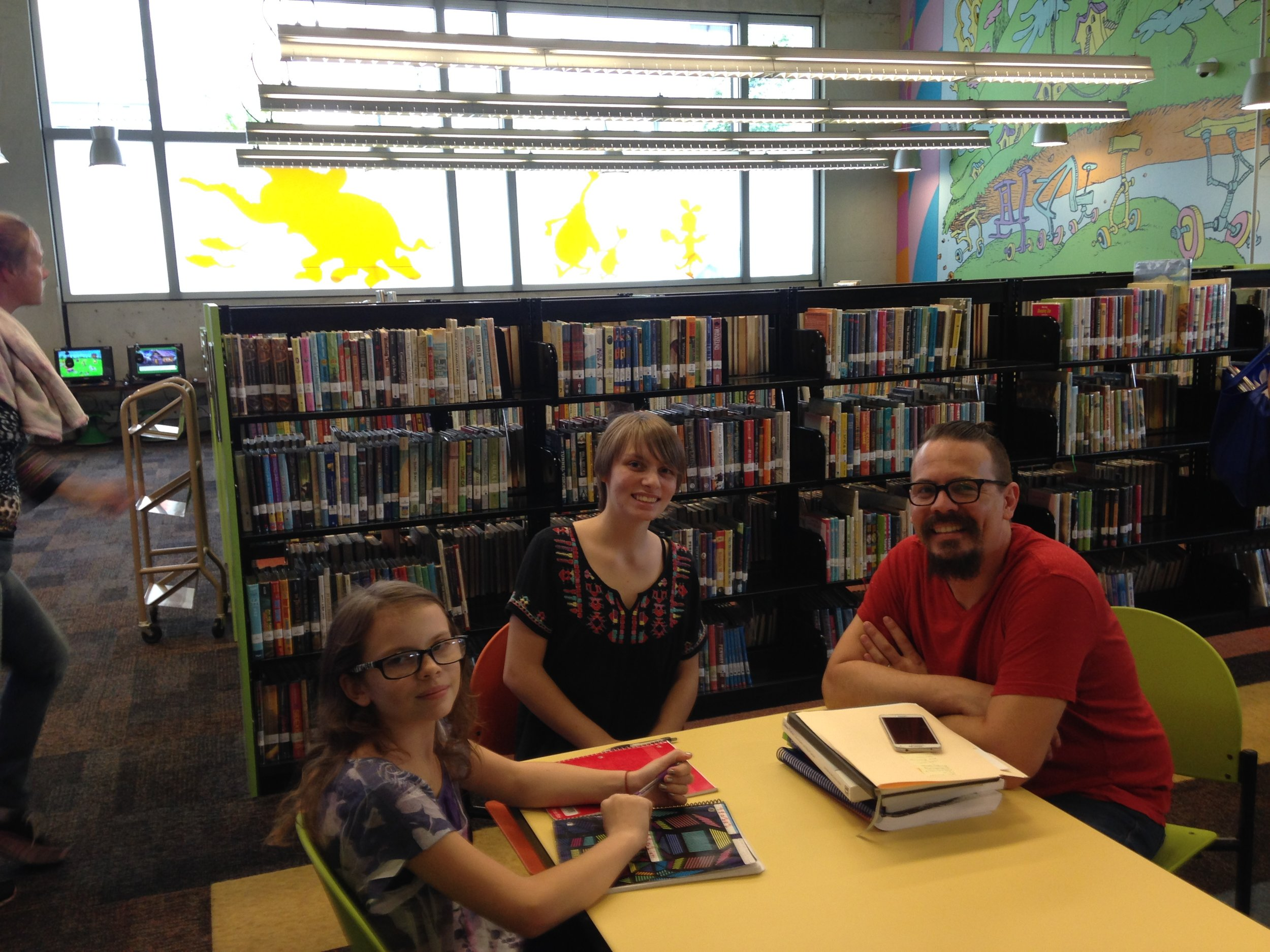 Isabel, Fabienne, and Ethan Sparks touring the Central Branch of the San Diego Public Library