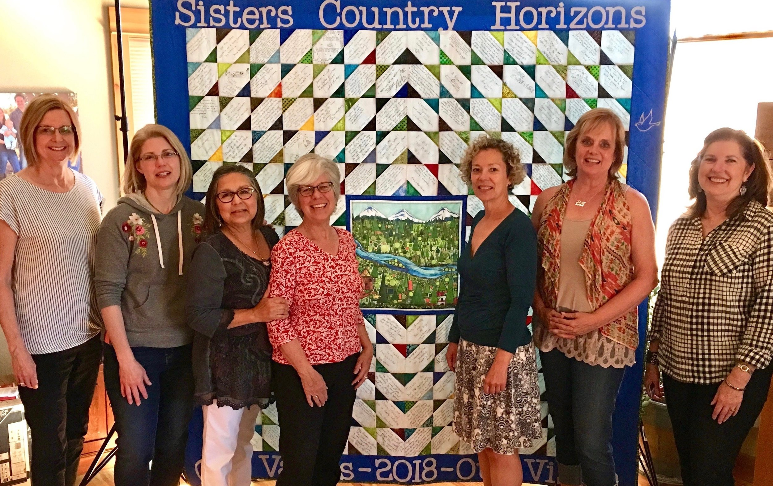 Celebrating the recent completion of the Sisters Country Quilt are, left to right, Nancy Frazeur, Amy Burgstahler, Gilda Hunt, Jeanette Pilak, Robyn Holdman, Diane Tolzman and Janet Storton.