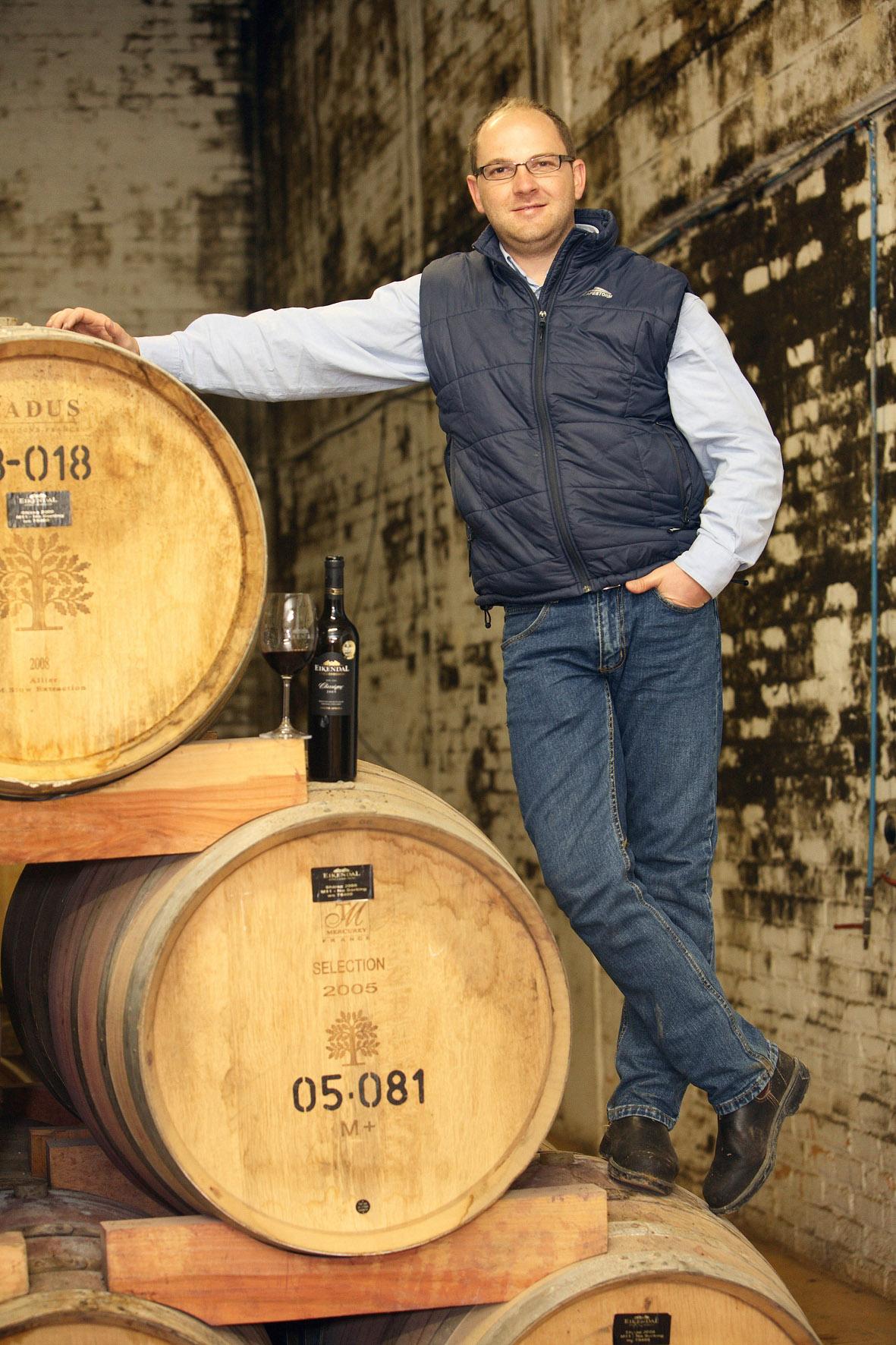 Eikendal Winemaker Nico Grobler and barrels Jumbo.jpg