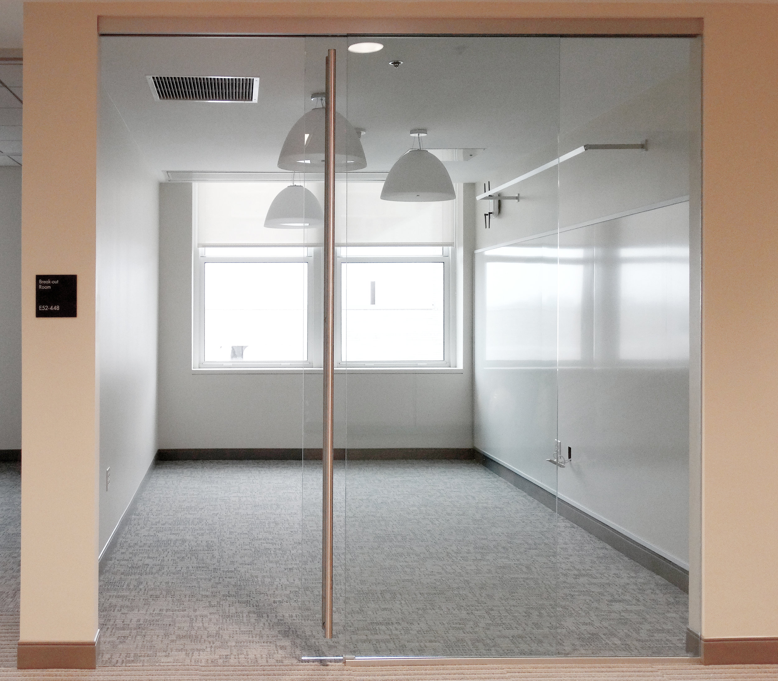 Illume Frameless Glass Sliding Door System - Spaceworks AI.jpg