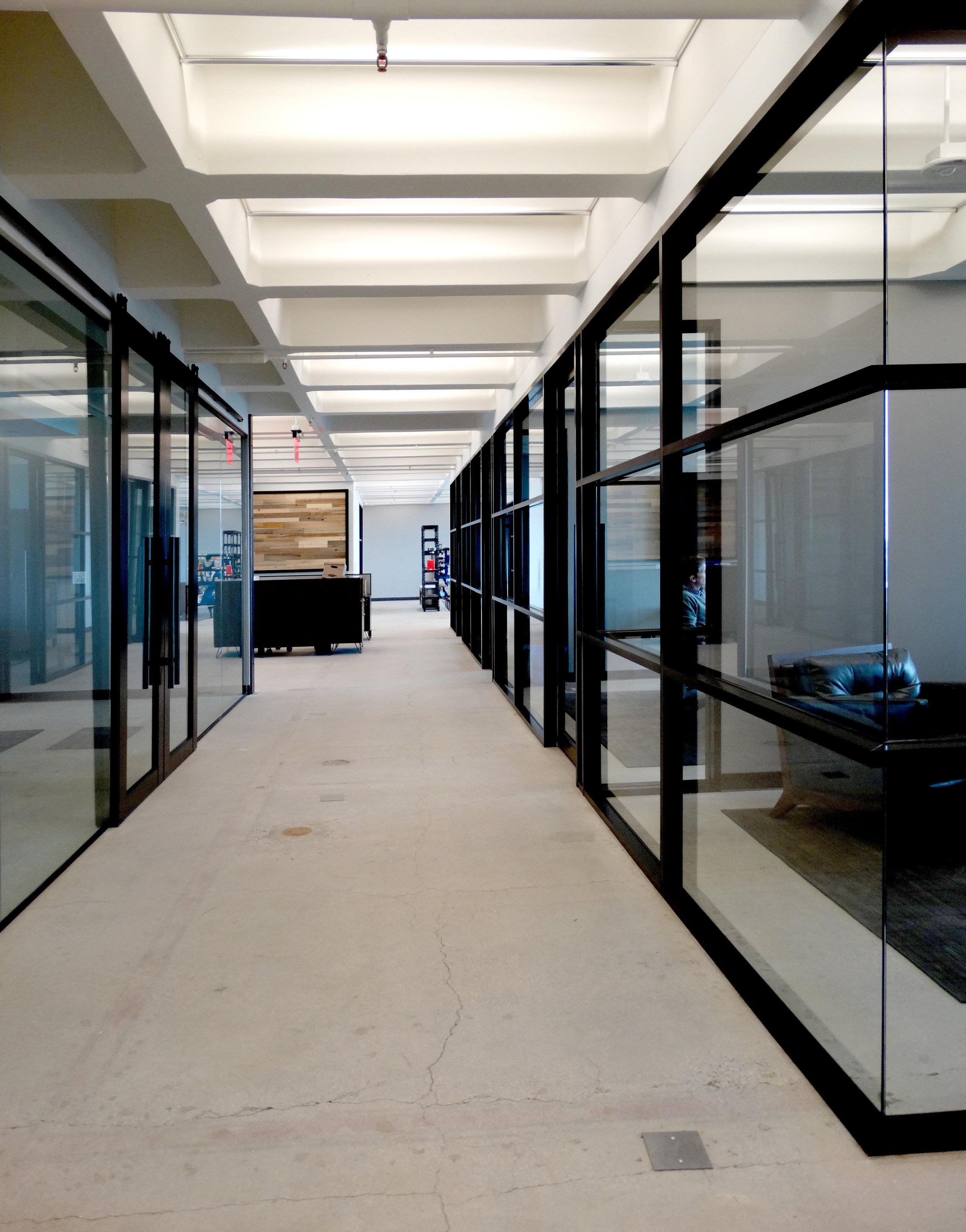 Encase Black Barn Door Bi-Parting Aluminum Framed Door Conference Room Wall - Spaceworks AI.JPG
