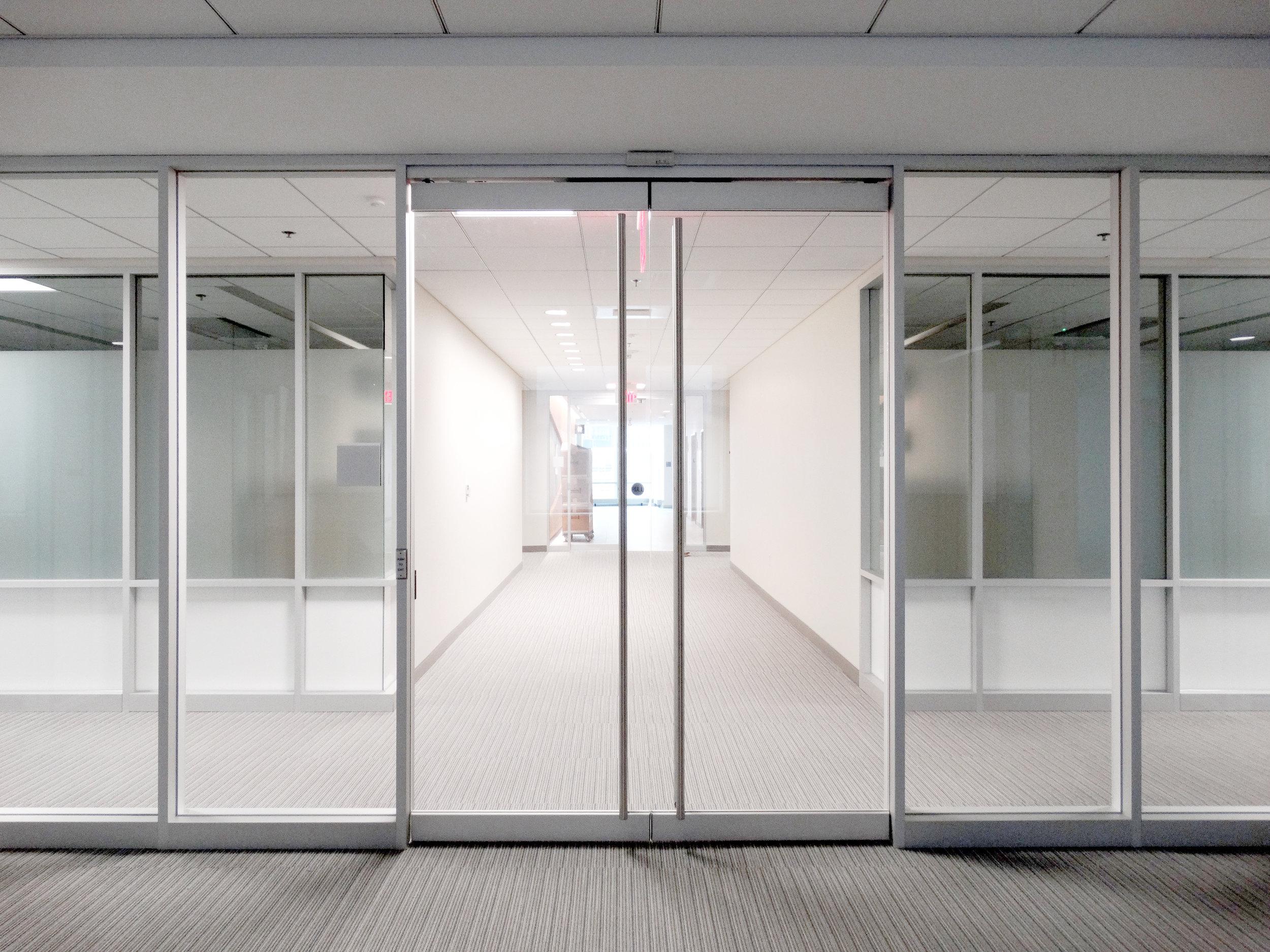 Encase Aluminum Framed Wall Frameless Rail Doors - Spaceworks AI.jpg