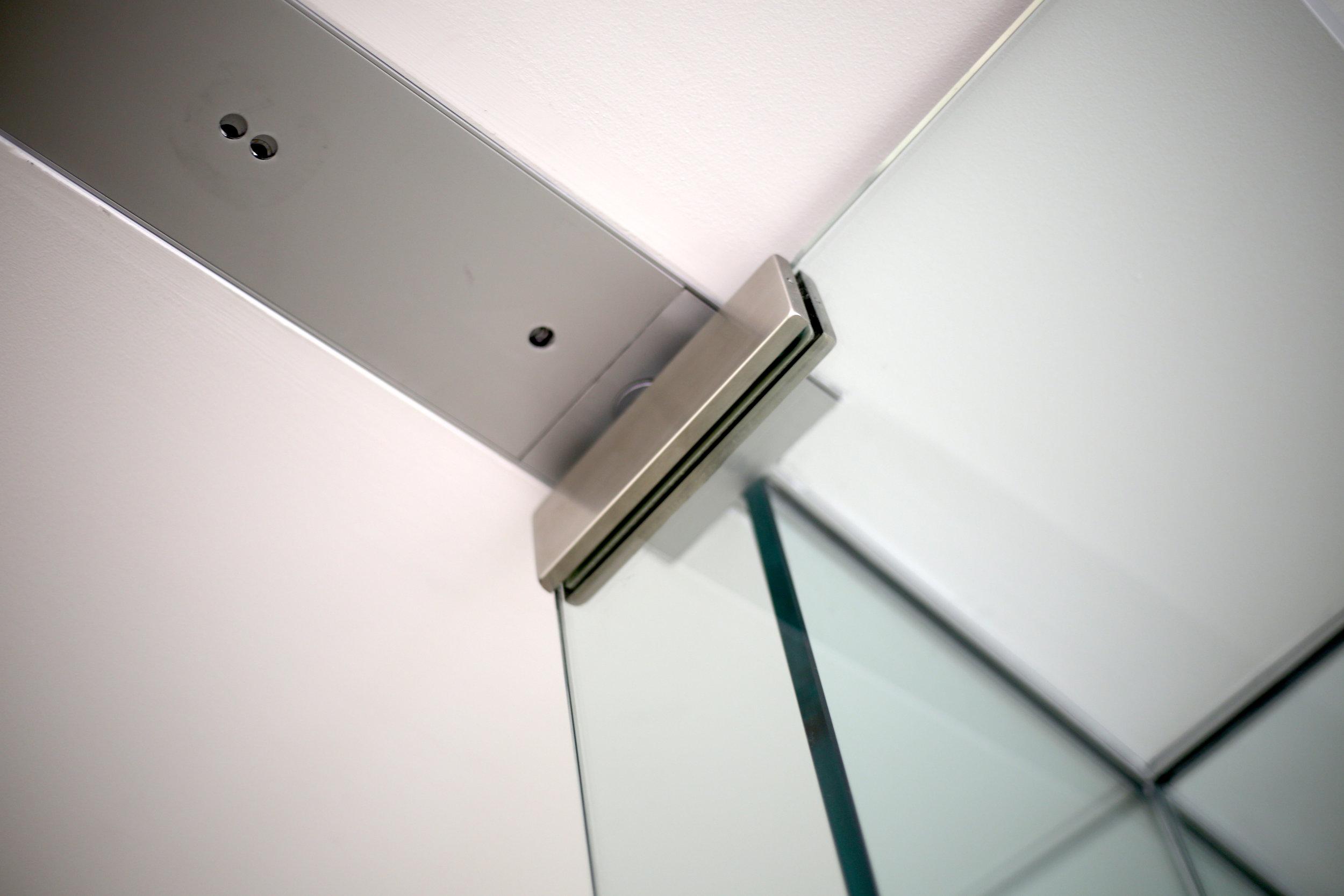 Illume Frameless Glass Door Header Tube - Spaceworks AI.jpg