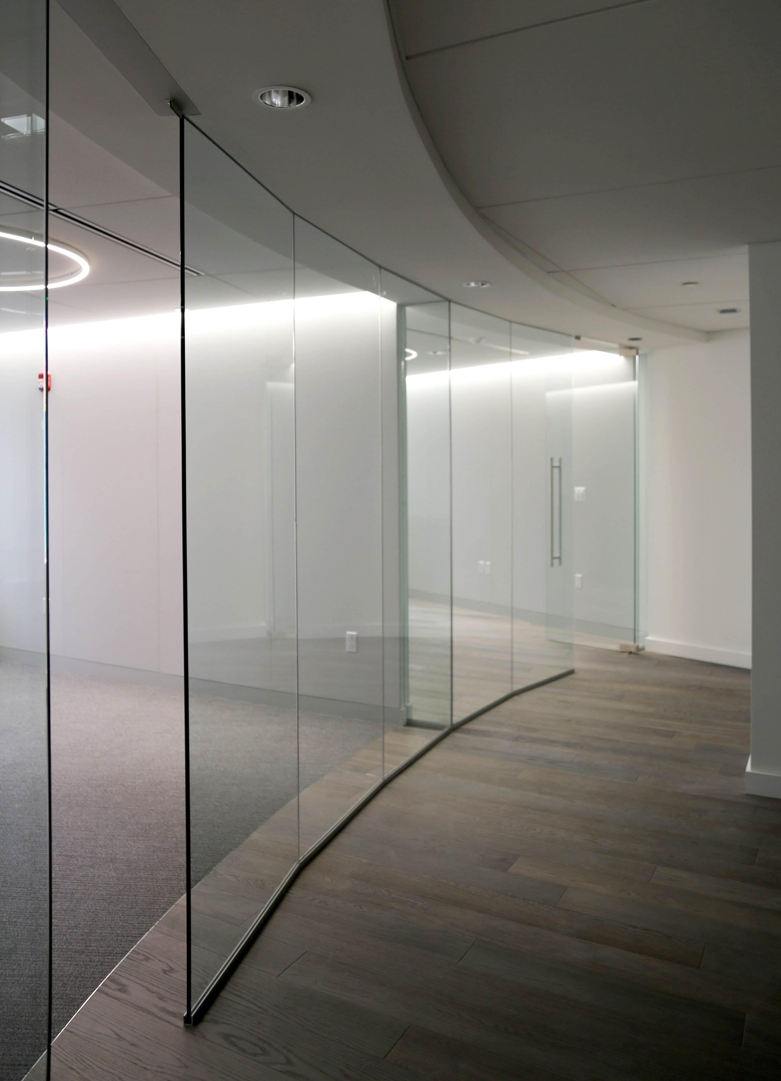 Illume Frameless Glass Faceted Wall - Spaceworks AI.jpg