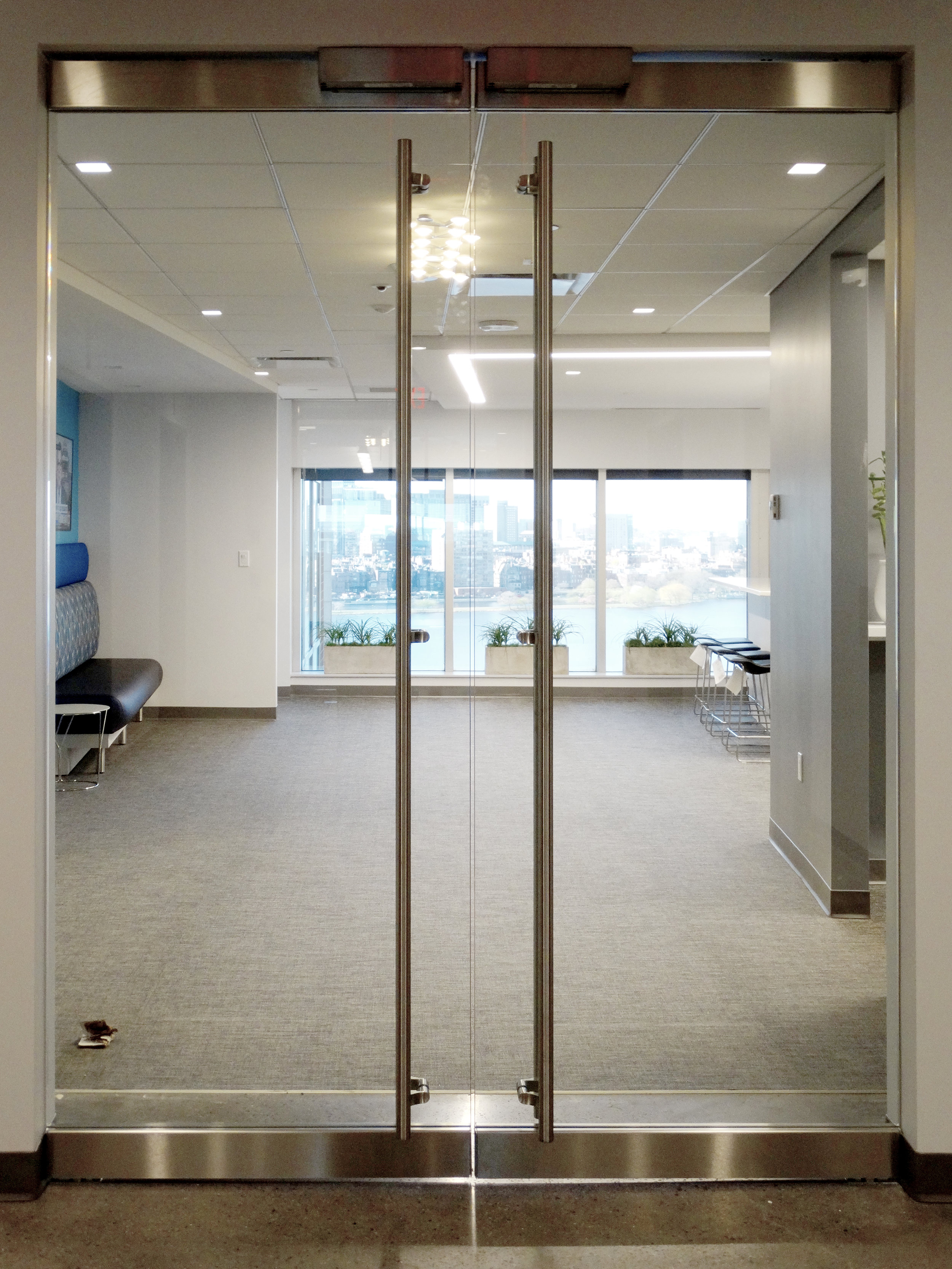 Illume Frameless Glass Rail Doors Offset Ladder Pulls Maglock - Spaceworks AI.jpg