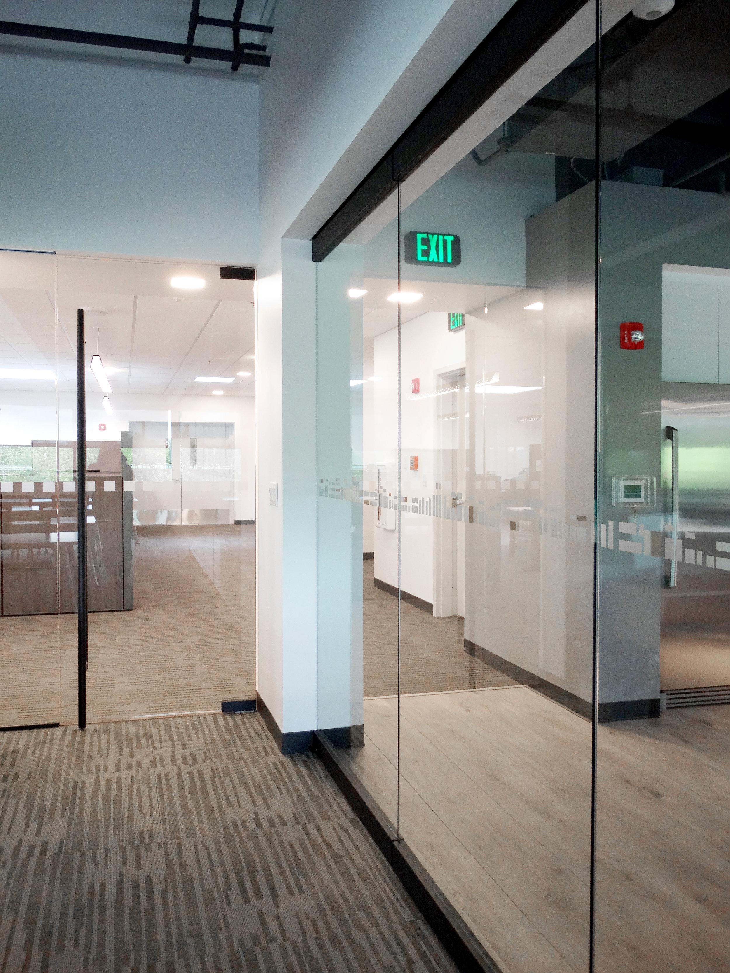 Illume Frameless Glass Sliding Wall - Spaceworks AI.jpg