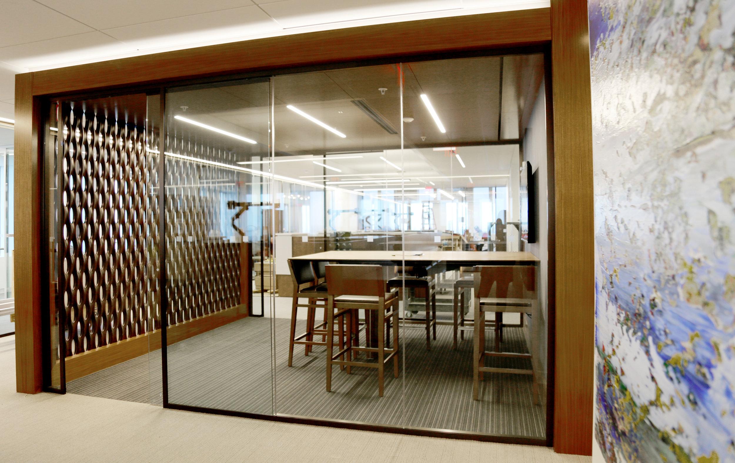 Modernus Dark Anodized Glass Conference Room - Spaceworks AI.jpg