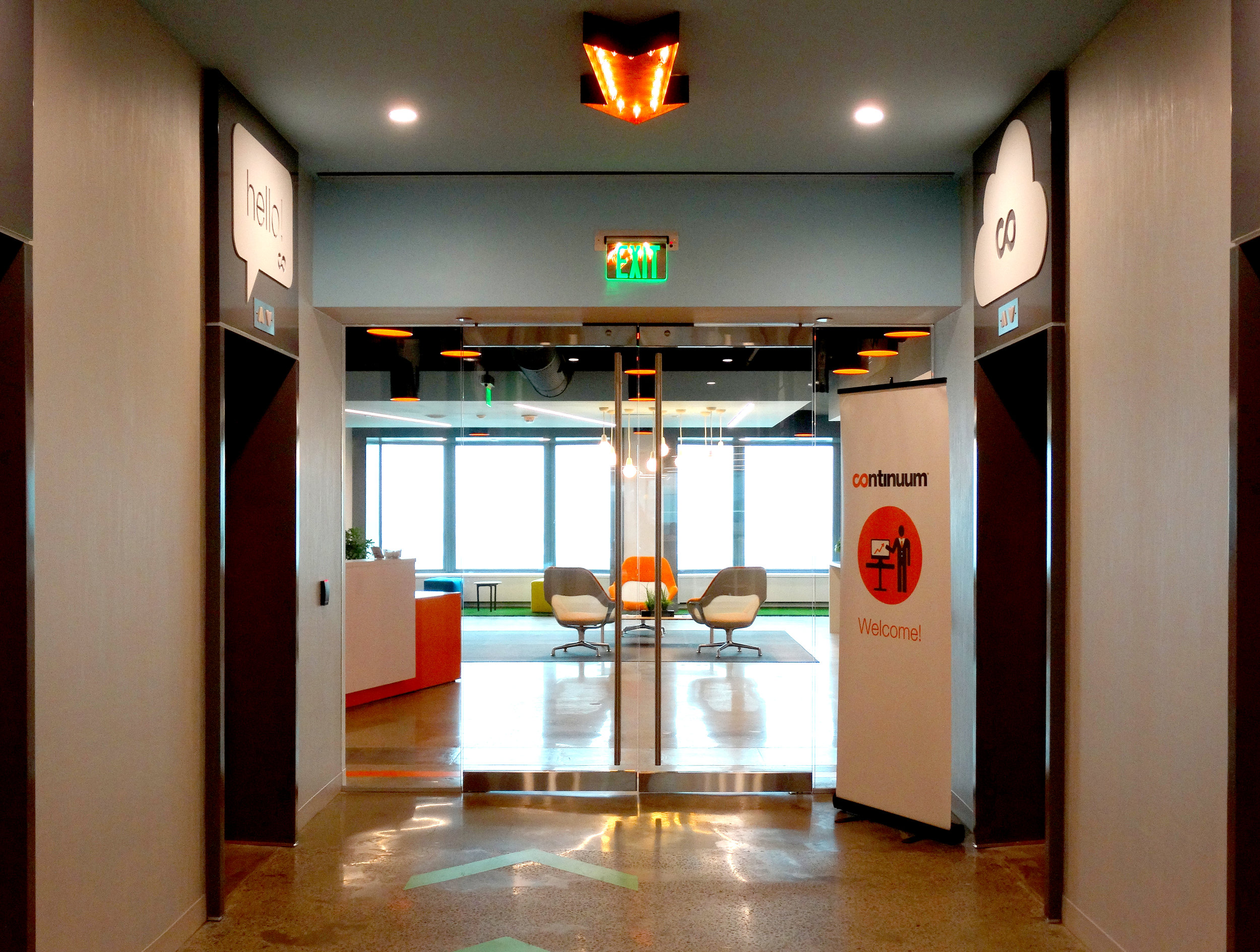 Illume Elevator Lobby Frameless Glass Rail Doors - Spaceworks AI.jpg