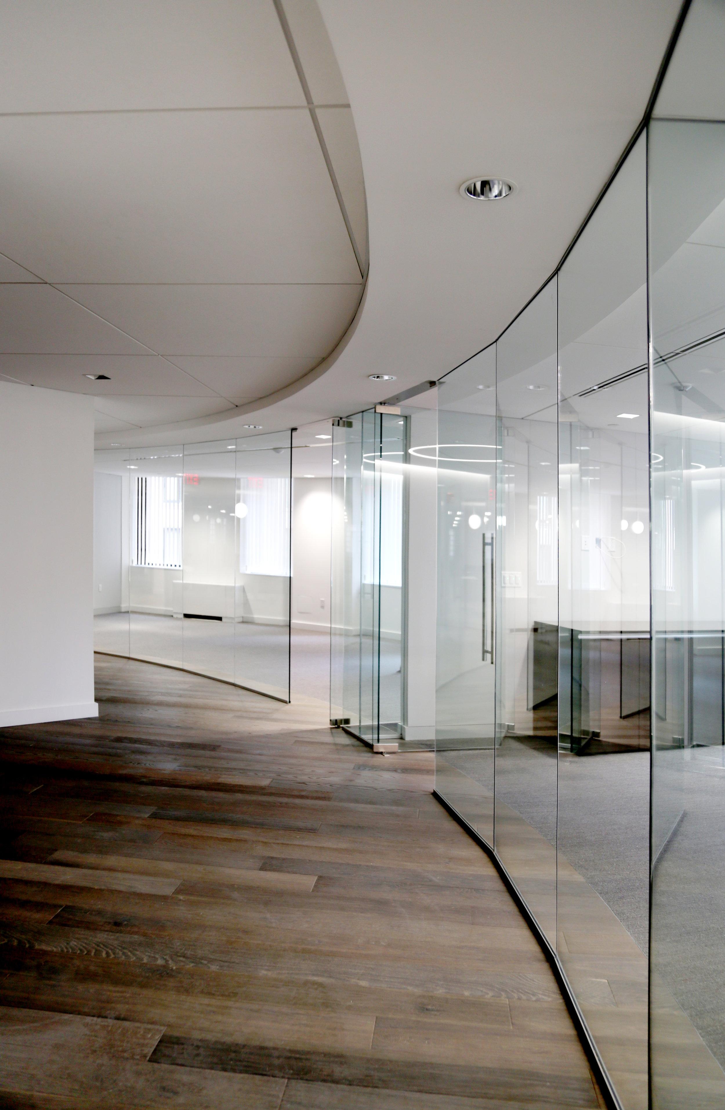 Illume Frameless Glass Curved Wall - Spaceworks AI.jpg