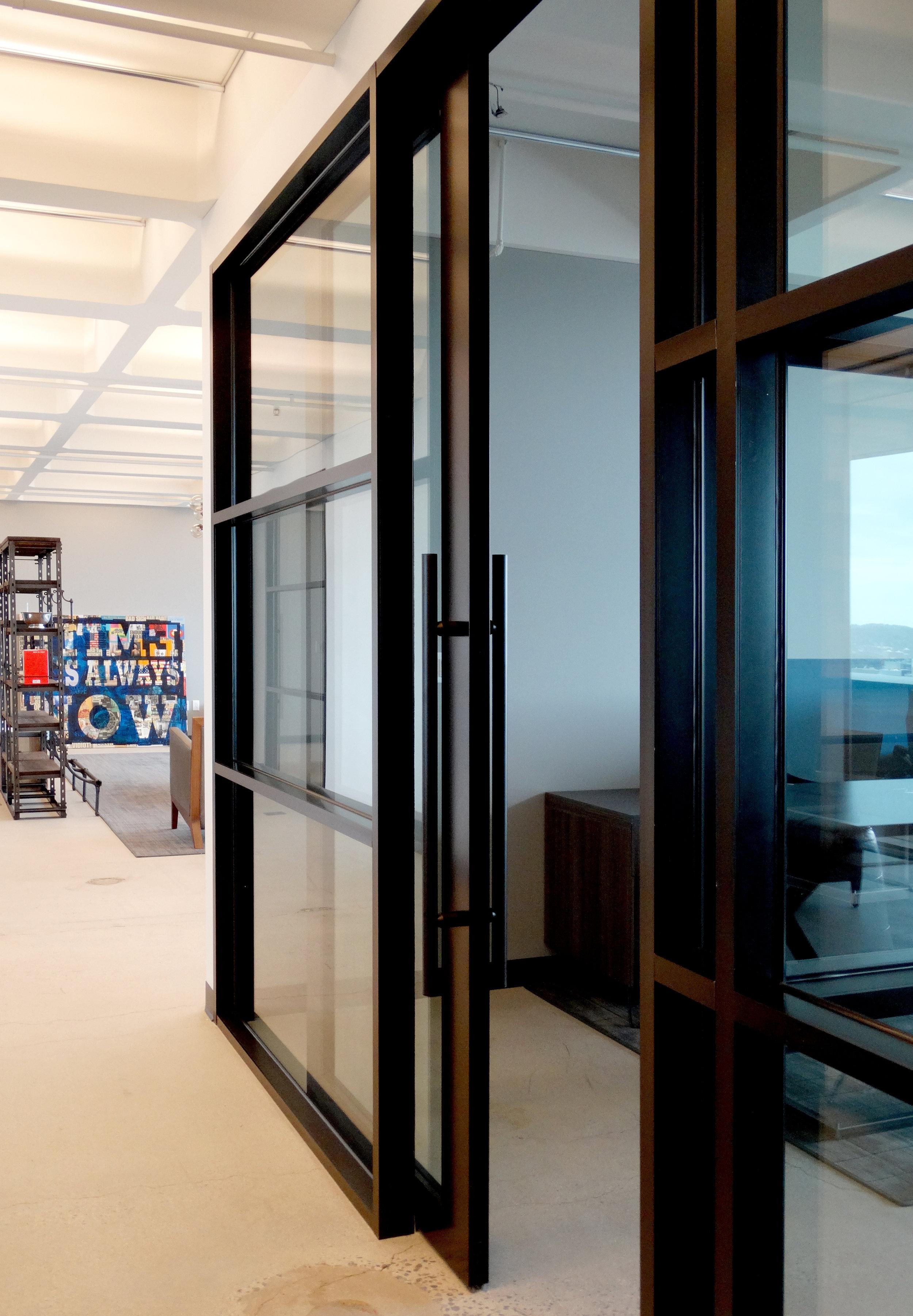 Encase Glass Aluminum Framed Sliding Door Office Wall - Spaceworks AI.JPG