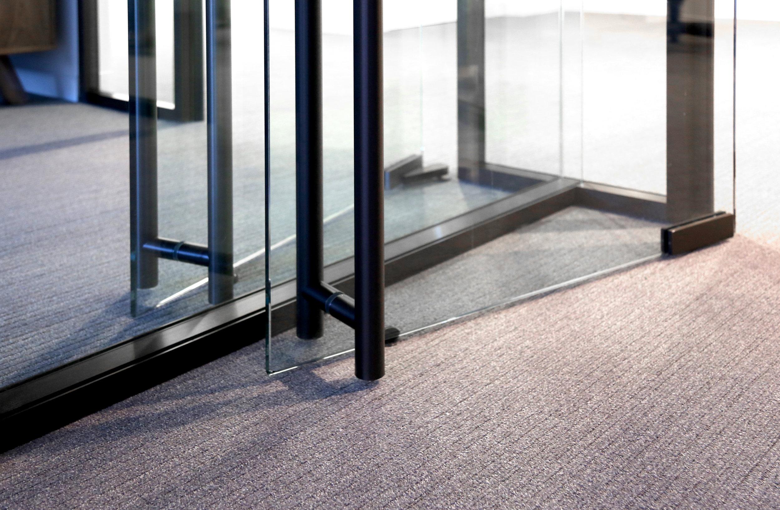 Modernus Back to Back Frameless Glass Pivot Doors Return - Spaceworks AI.jpg