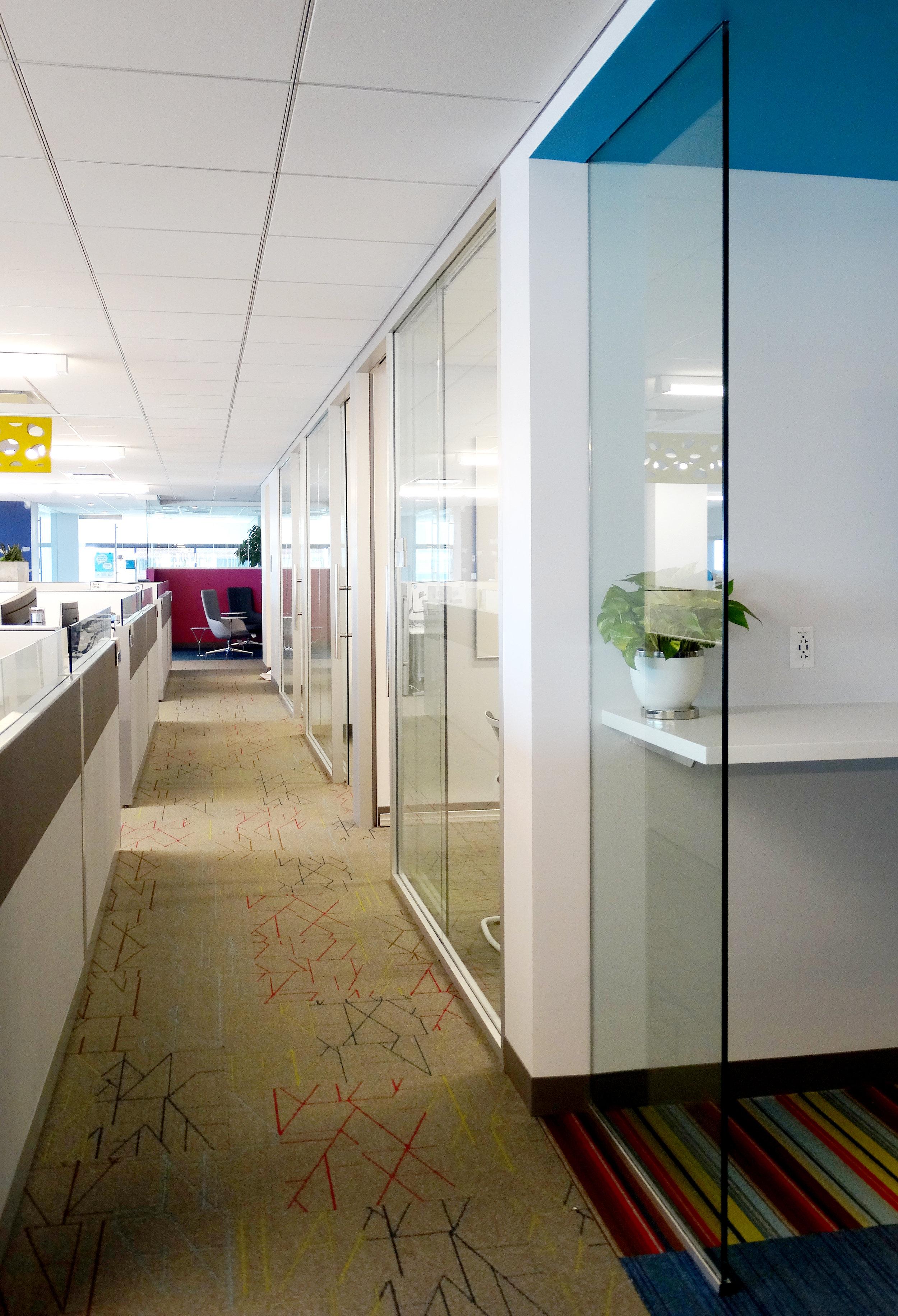 Illume Frameless Glass Reception Area - Spaceworks AI.jpg