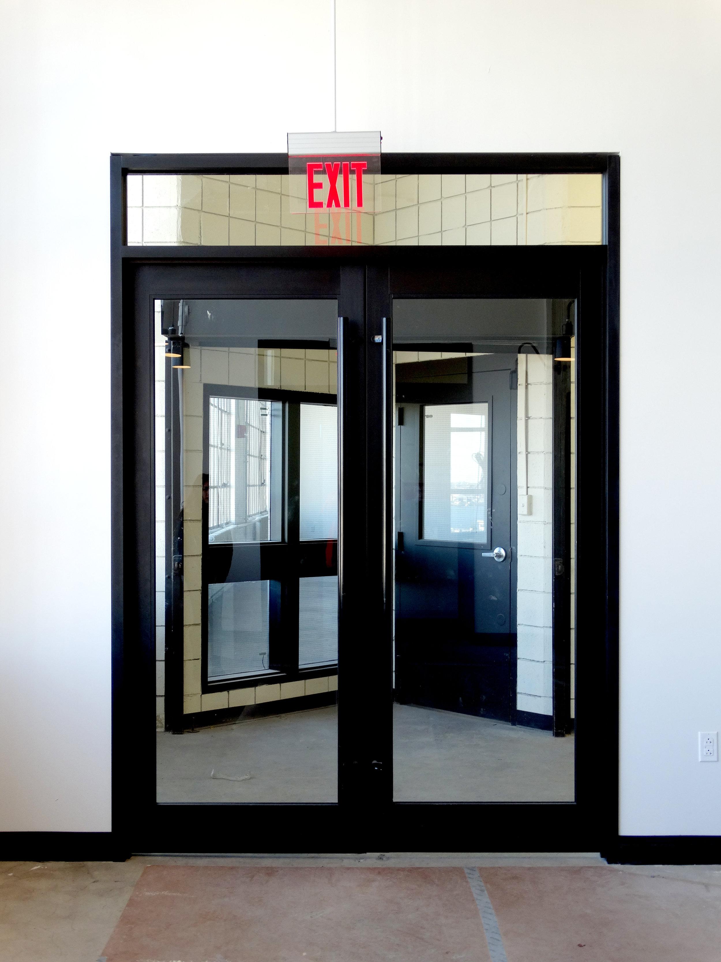 Encase Black Aluminum Elevator Lobby Doors - Spaceworks AI.jpg