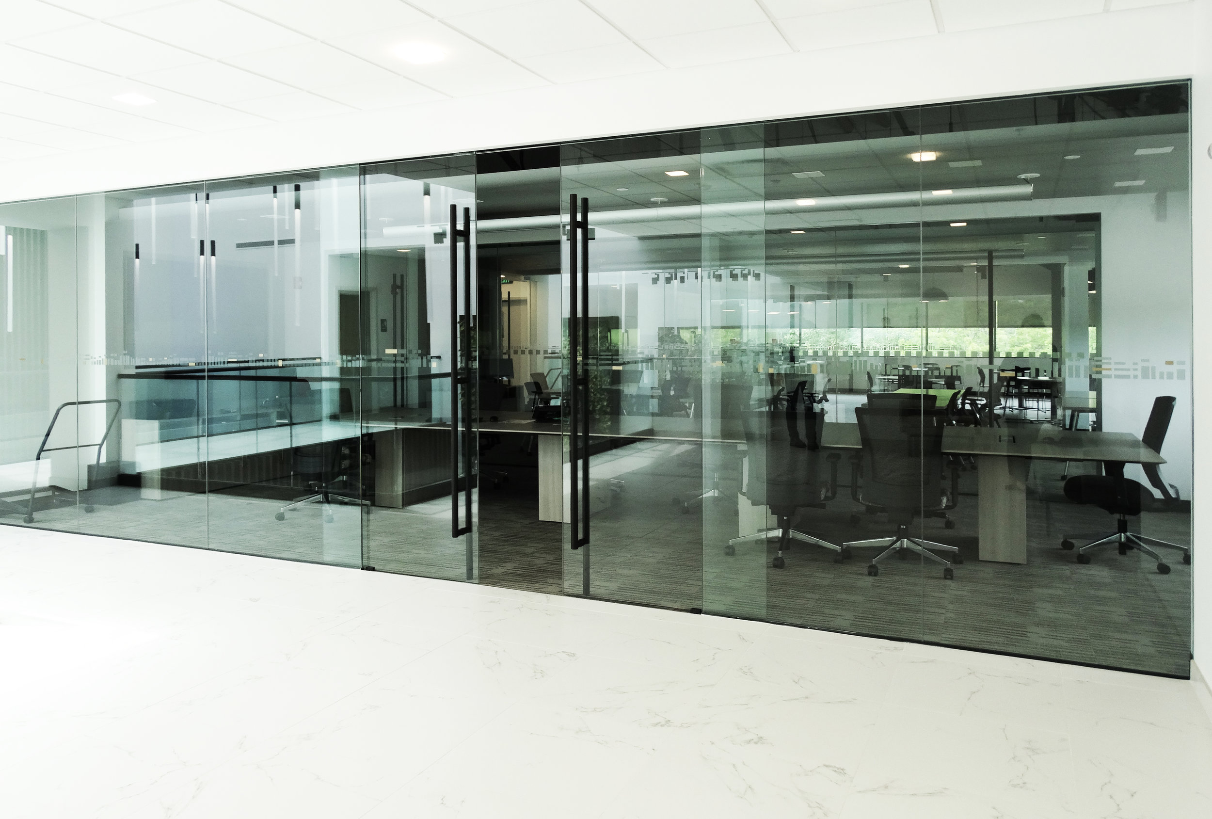ILLUME - A frameless glass system with a clean profile and multiple door technology options - perfect for entry ways and conference rooms.