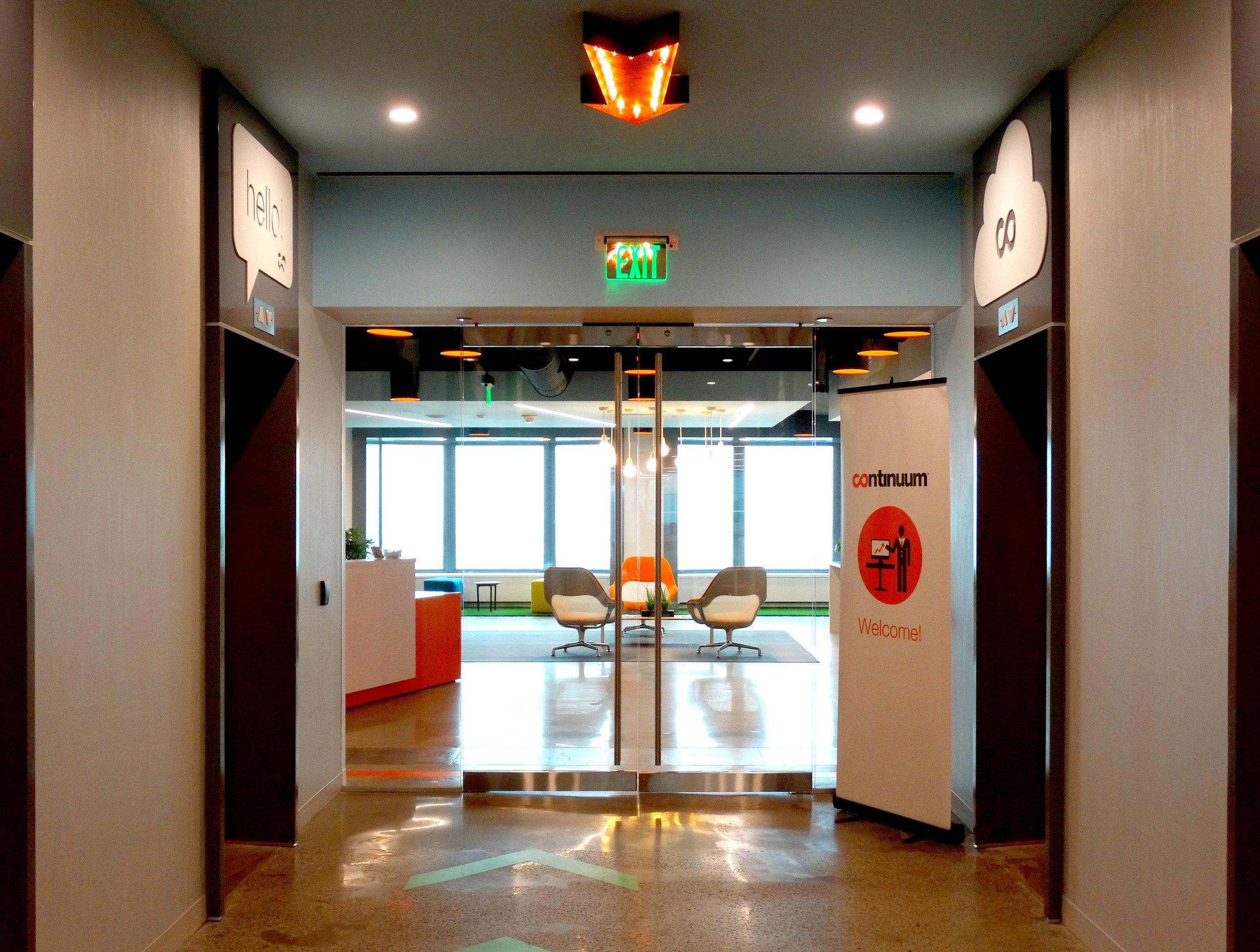 Illume Elevator Lobby Frameless Glass Rail Doors - Spaceworks AI.jpg