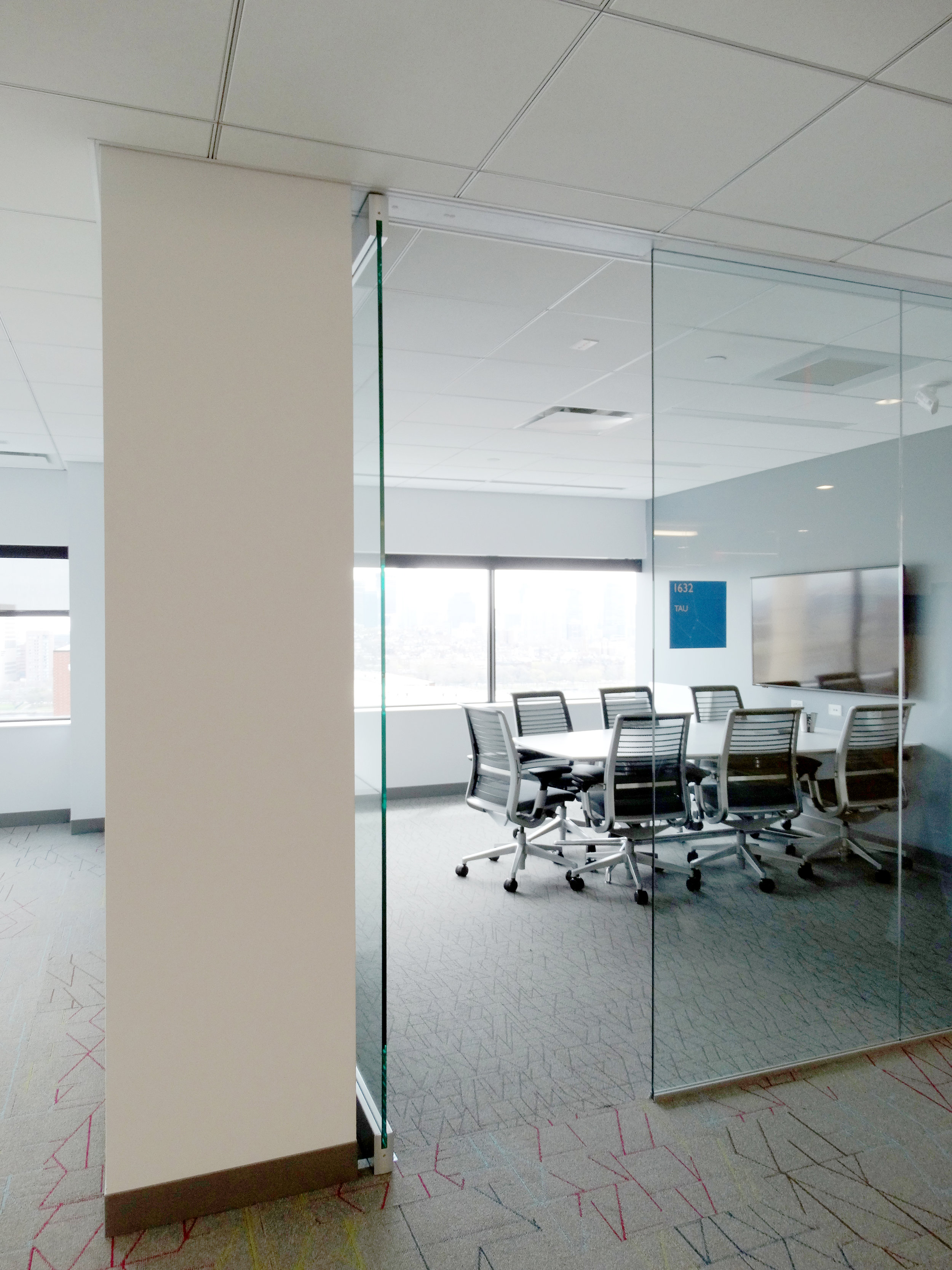 Illume Frameless Glass Conference Room Door - Spaceworks AI.jpg