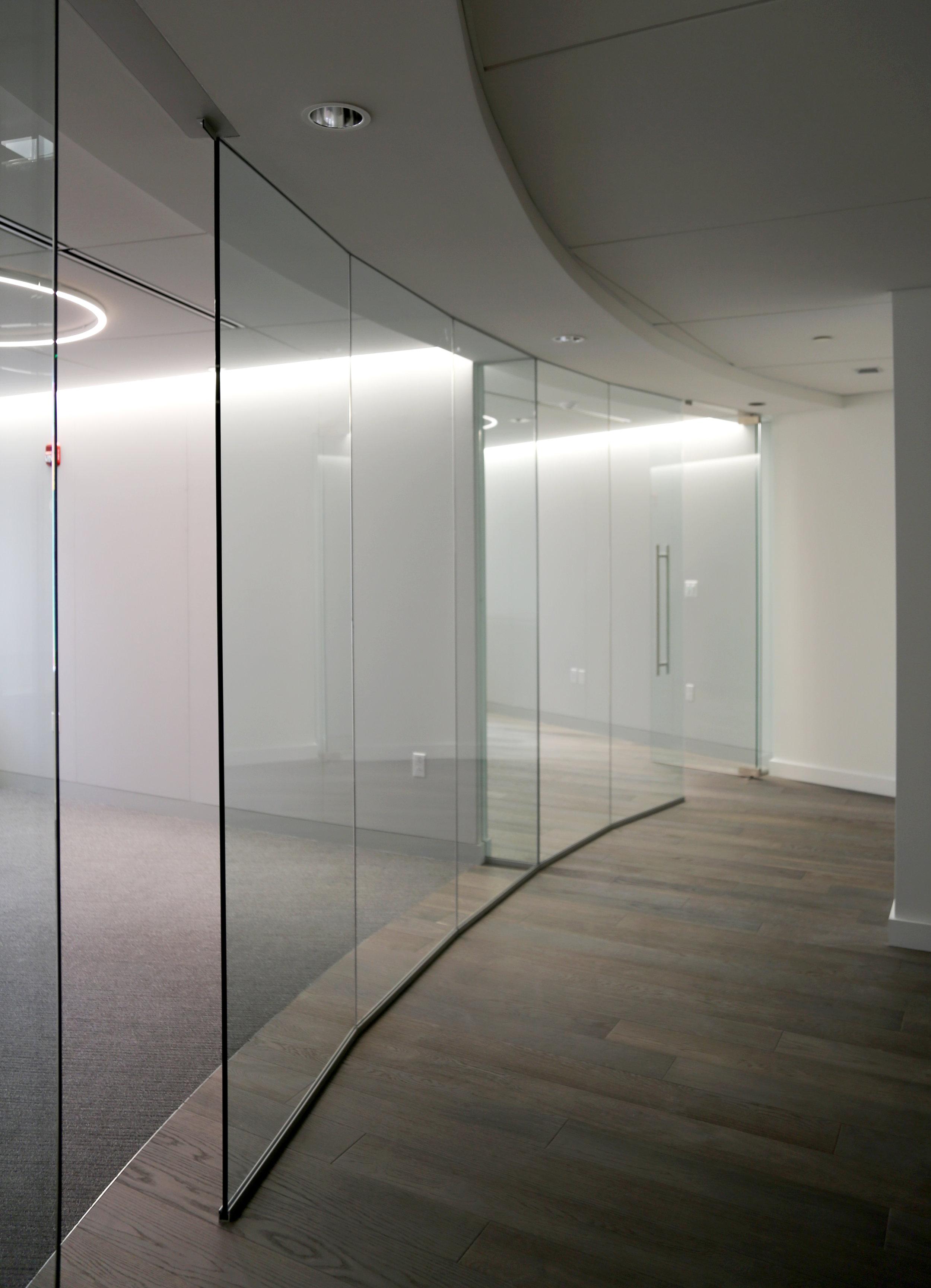 Illume Frameless Glass Faceted Wall - Spaceworks AI.jpg