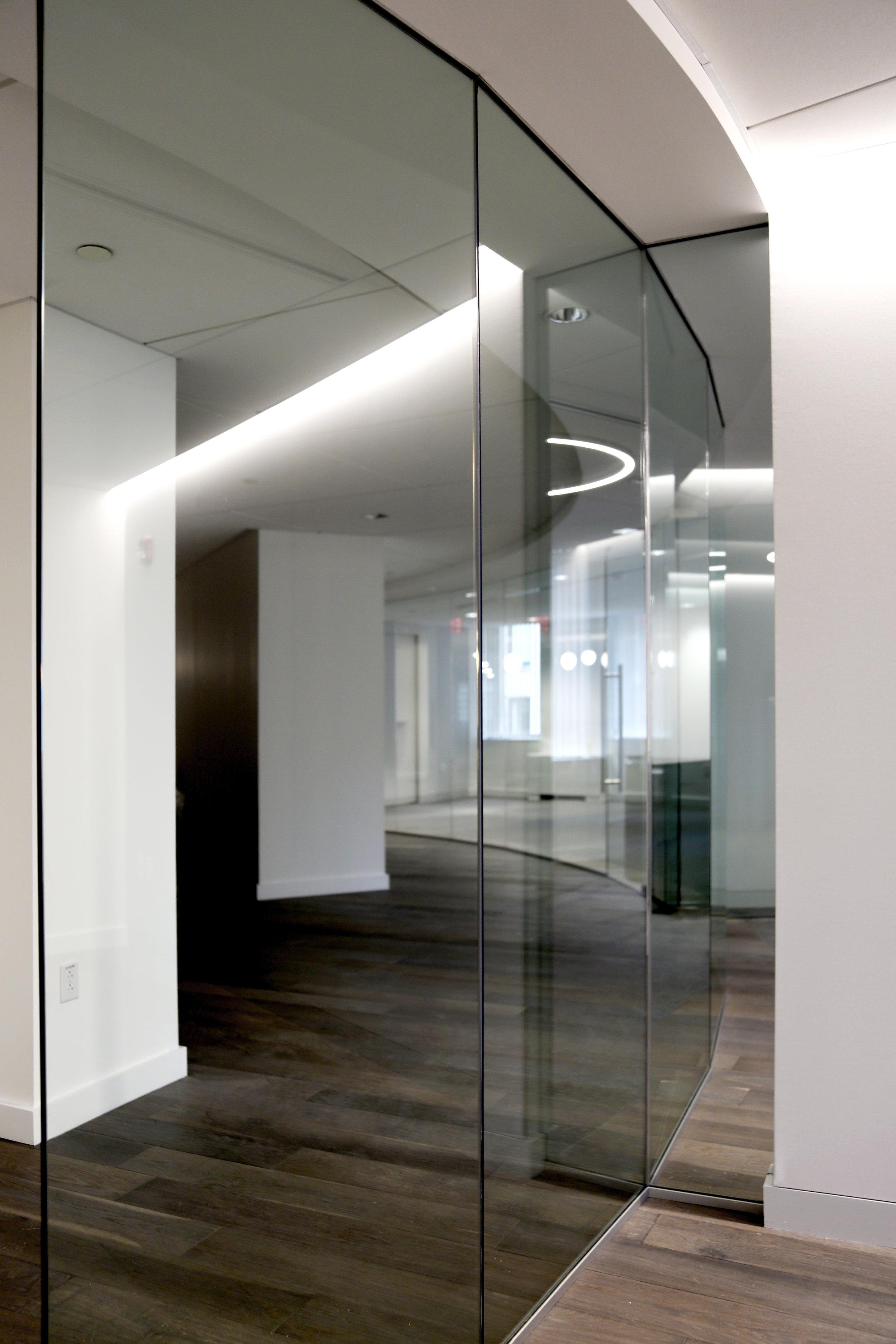 Illume Frameless Glass Wall Curved - Spaceworks AI.jpg