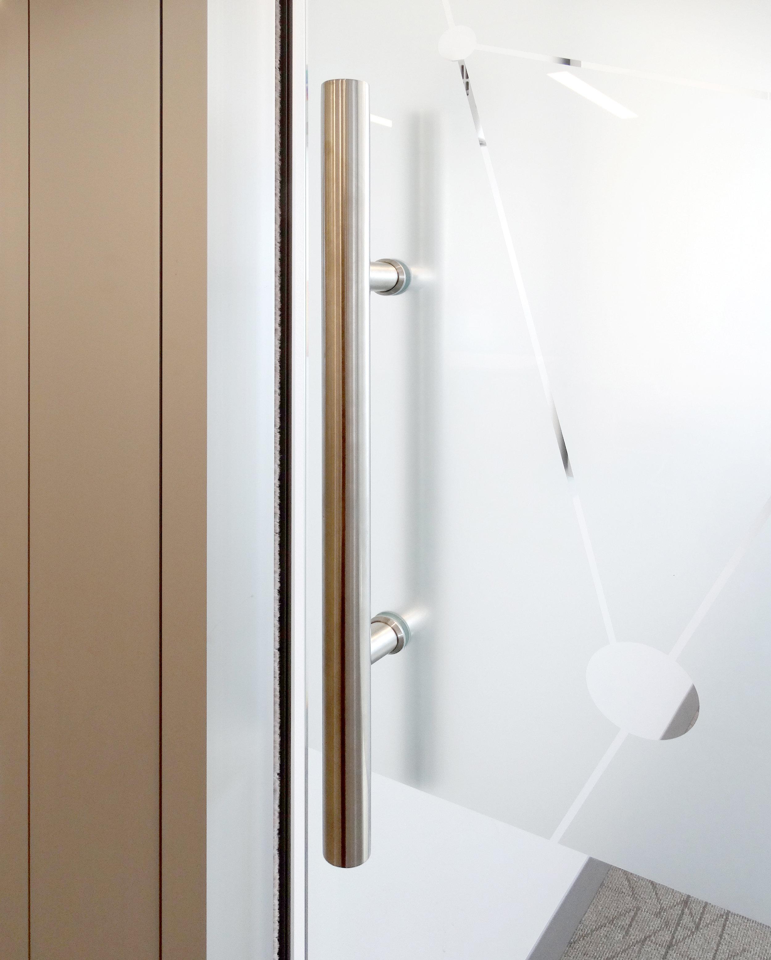 Litespace Satin Stainless Ladder Pull Frameless Glass Door - Spaceworks AI.jpg
