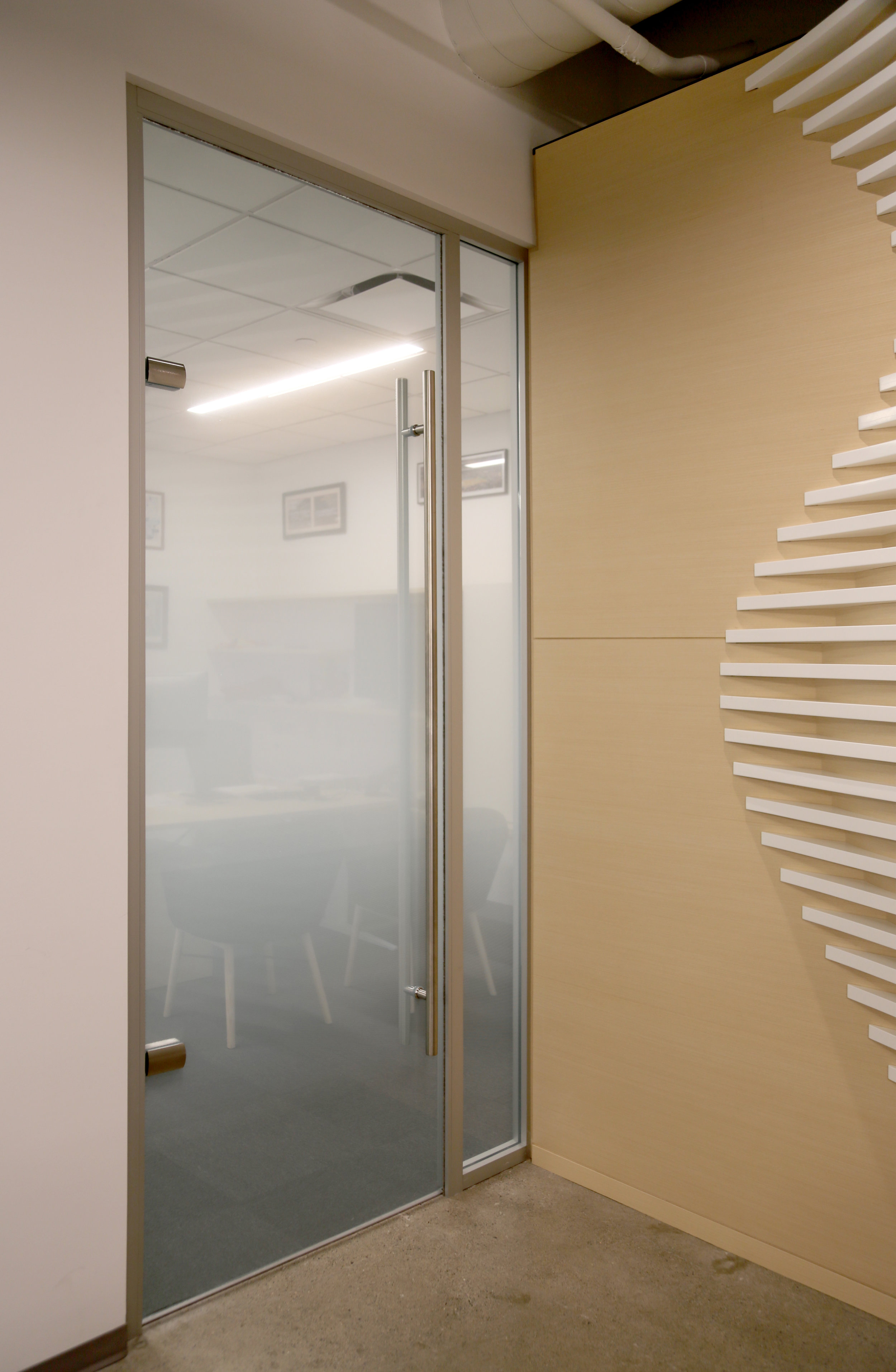 Frameless Glass Hydraulic Hinge Door - Spaceworks AI