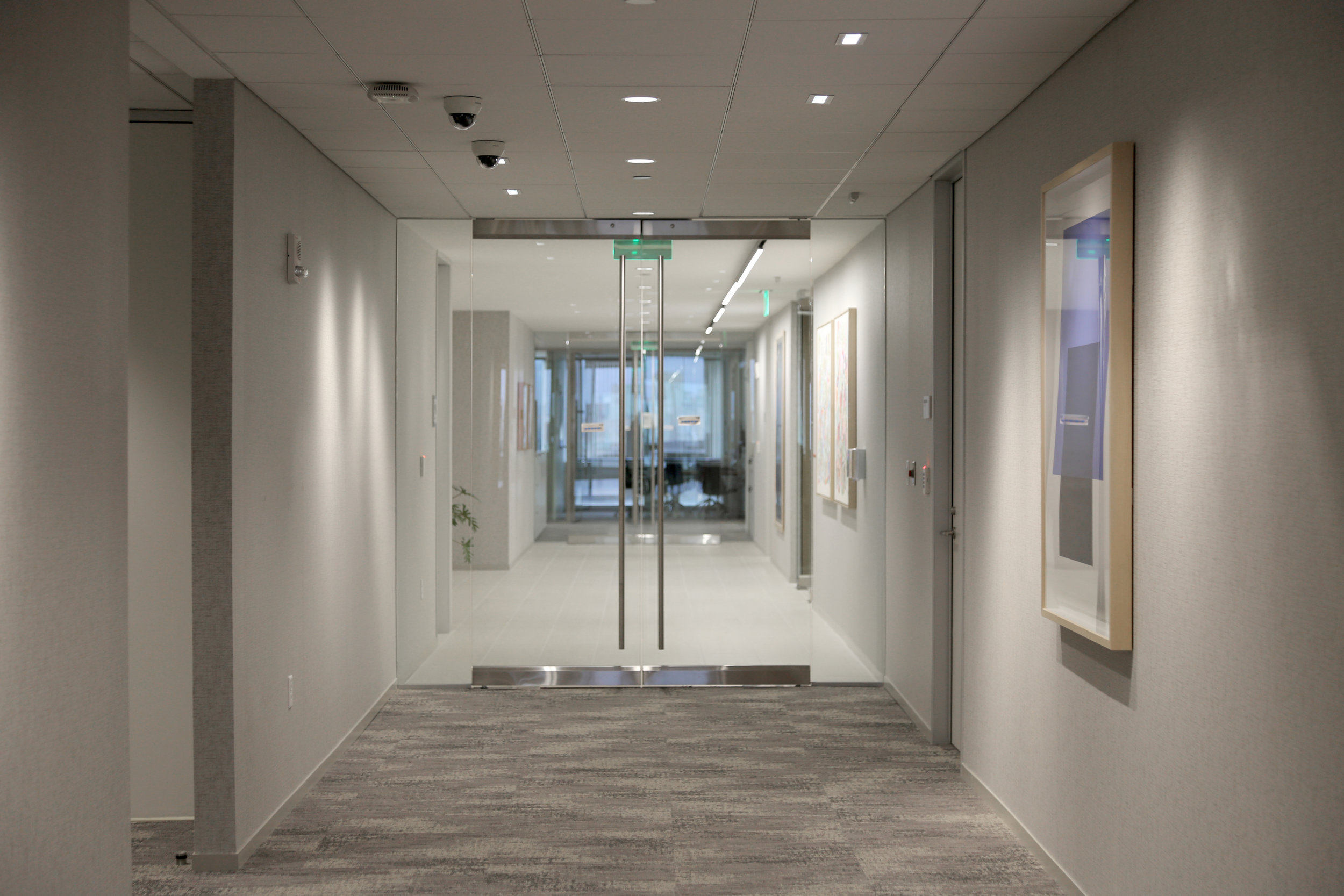 Frameless Glass Entry Doors Maglock System Elevator Lobby - Spaceworks AI.jpg