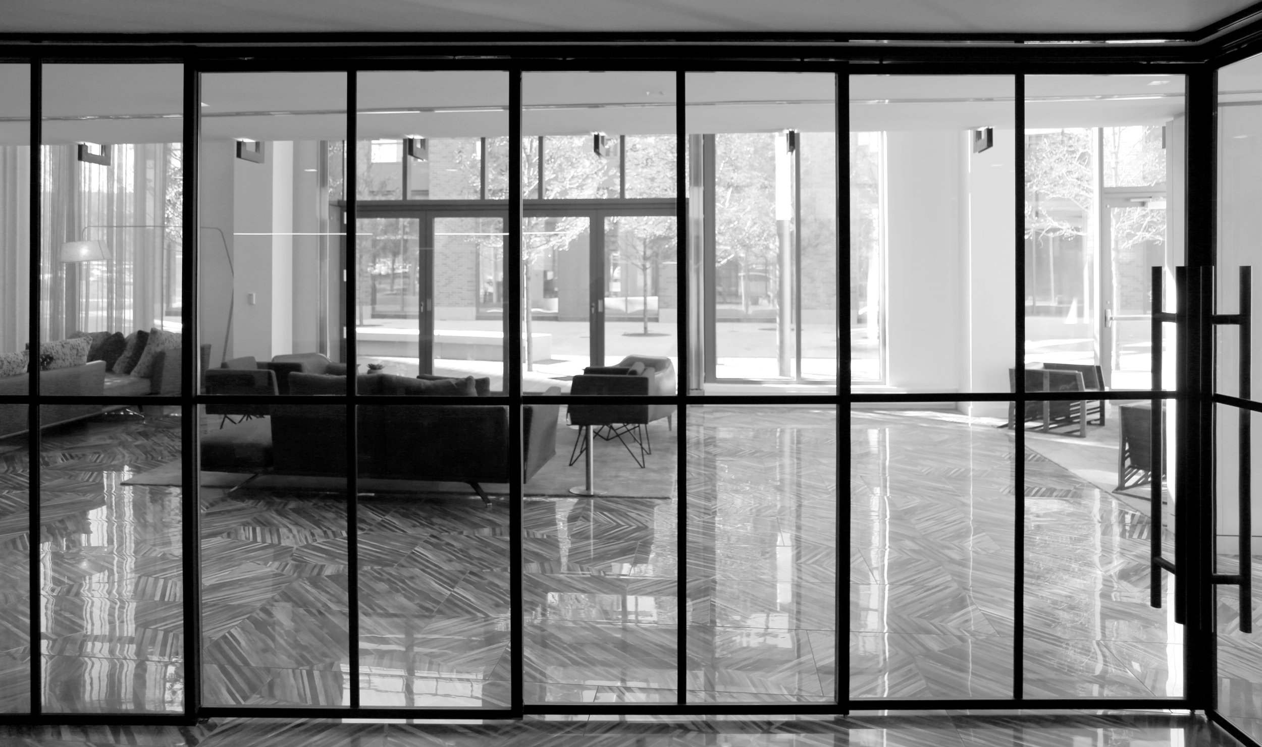 Black Anodized Applied Glass Mullions Sliding Wall System - Spaceworks AI.jpg