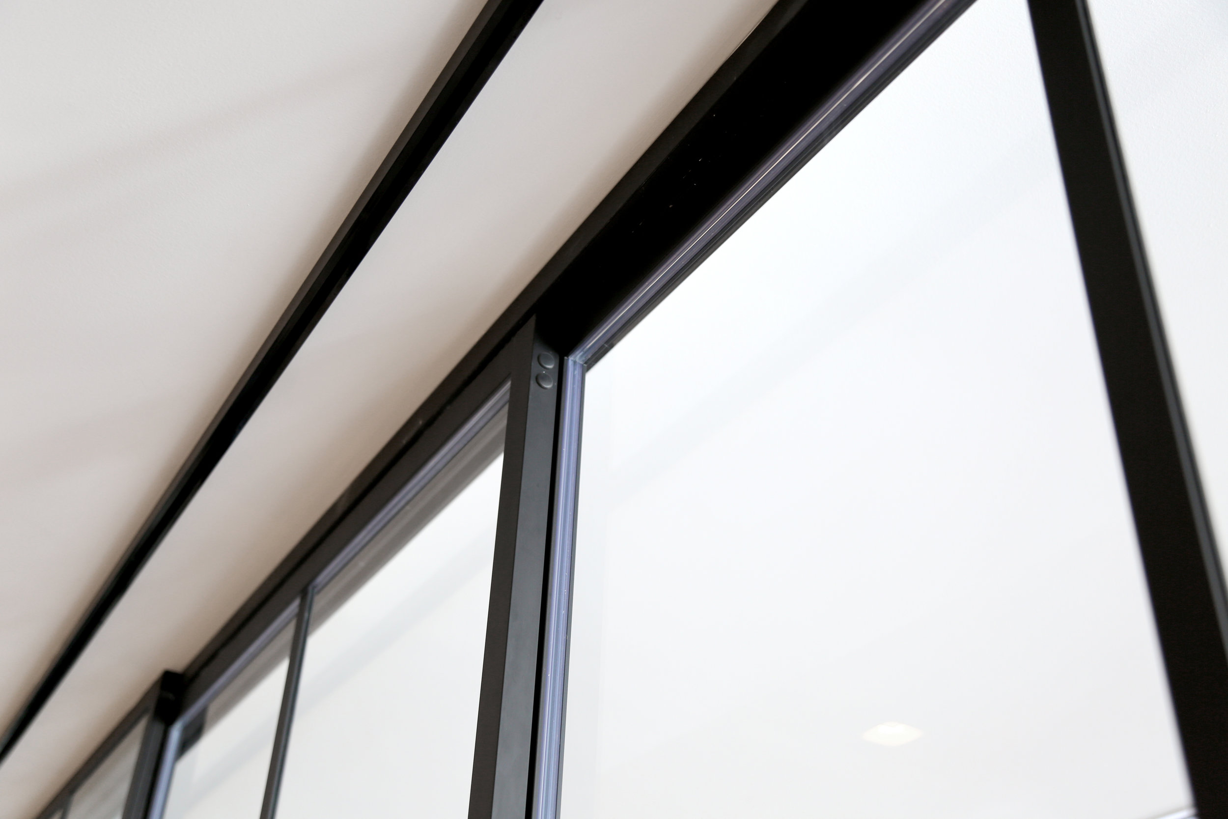 Glass Panels Black Aluminum Sliding Wall System - Spaceworks AI.jpg