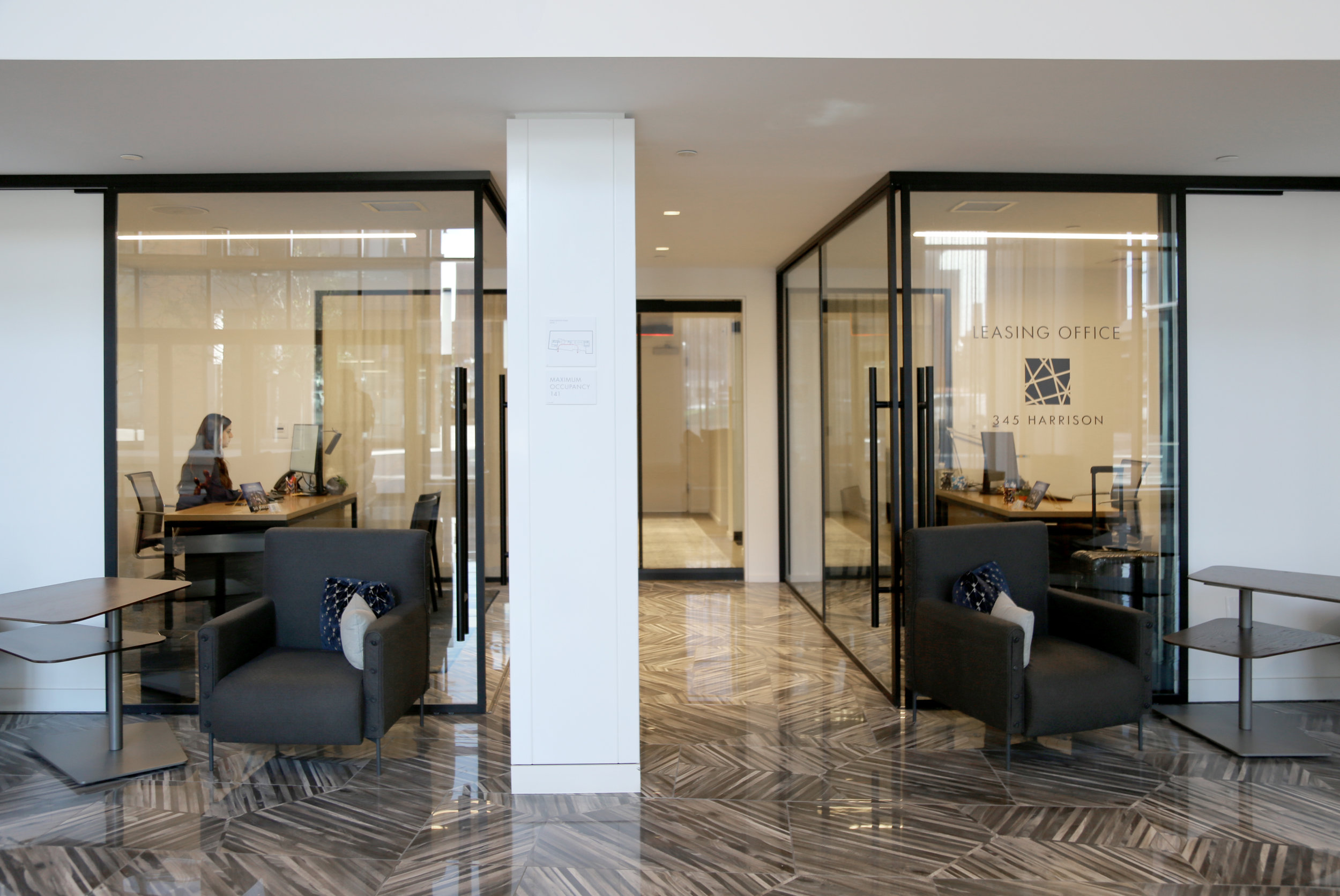 Leasing Office Glass Walls Frameless Glass Sliding Doors - Spaceworks AI.jpg