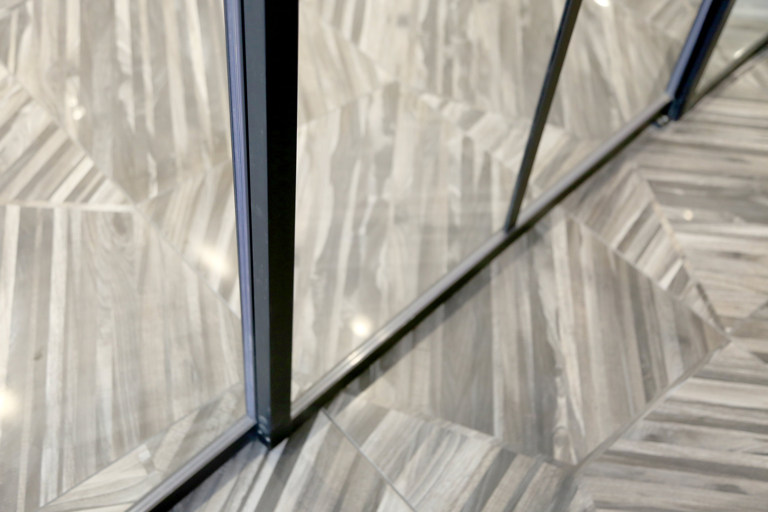 Lobby Telescoping Glass Wall Panels Black Aluminum Narrow Profile - Spaceworks AI.jpg