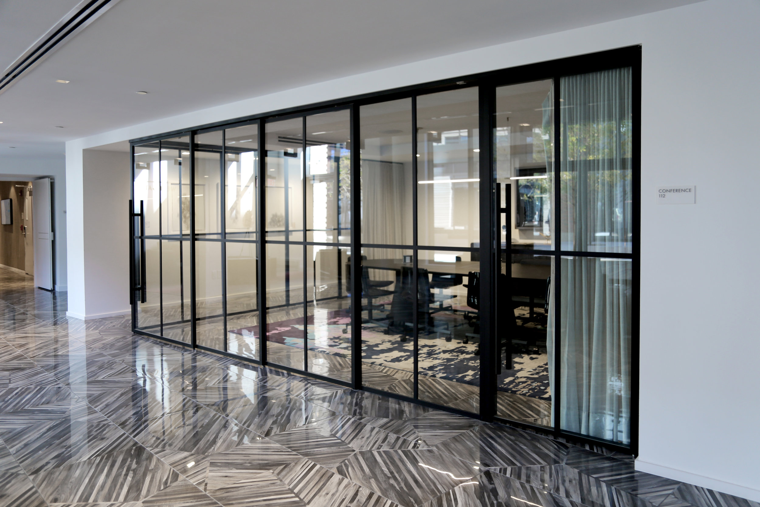 Modernus Black Anodized Sliding Glass Wall System - Spaceworks AI.jpg