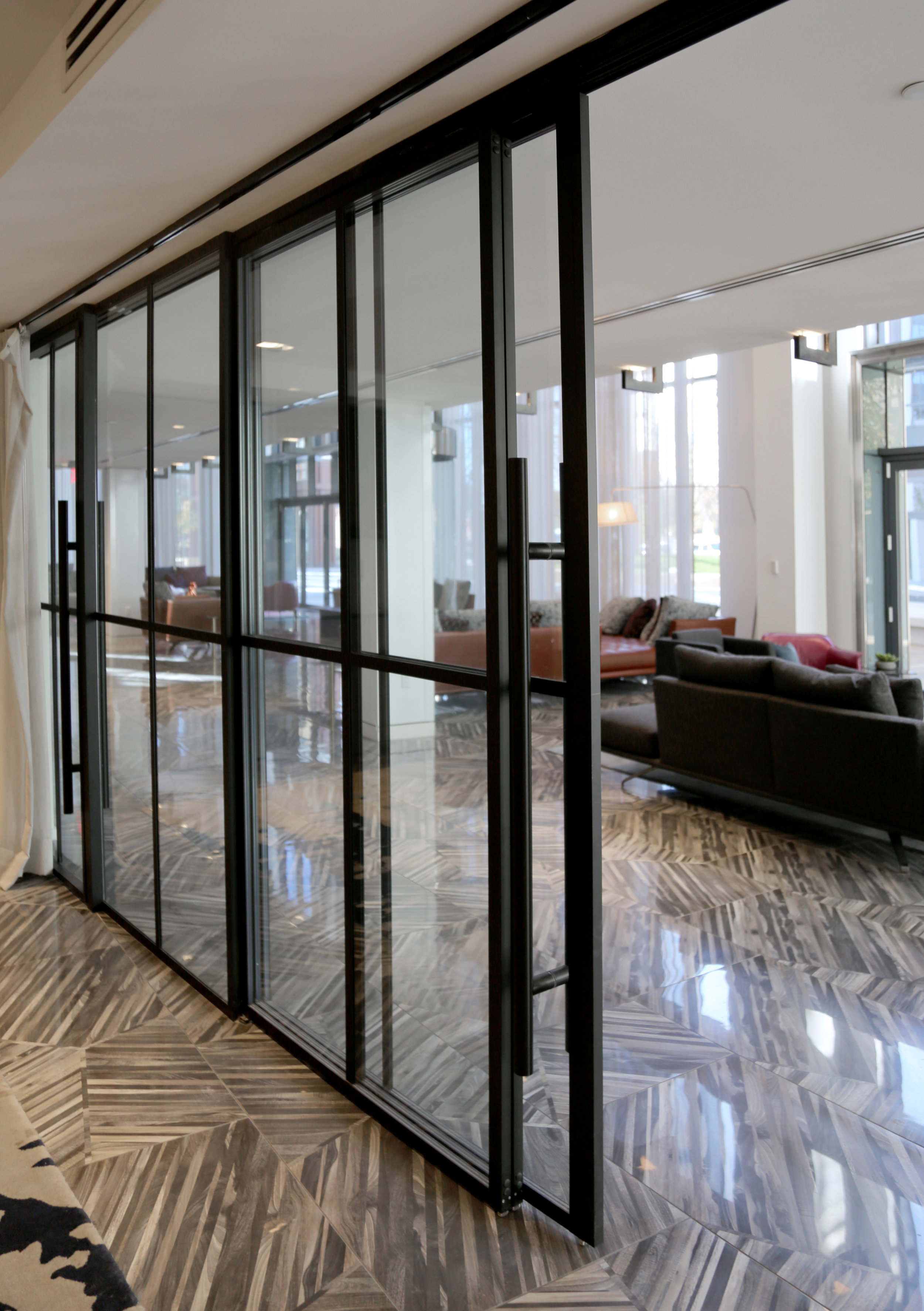 Modernus Black Anodized Sliding Wall Telescoping System Applied Mullions Sliding Door - Spaceworks AI.jpg