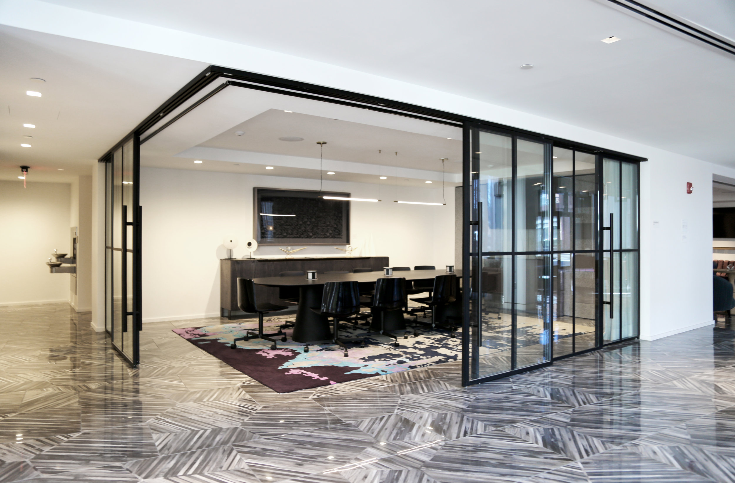 Modernus Telescoping Perpendicular Glass Wall Conference Room Open - Spaceworks AI.jpg
