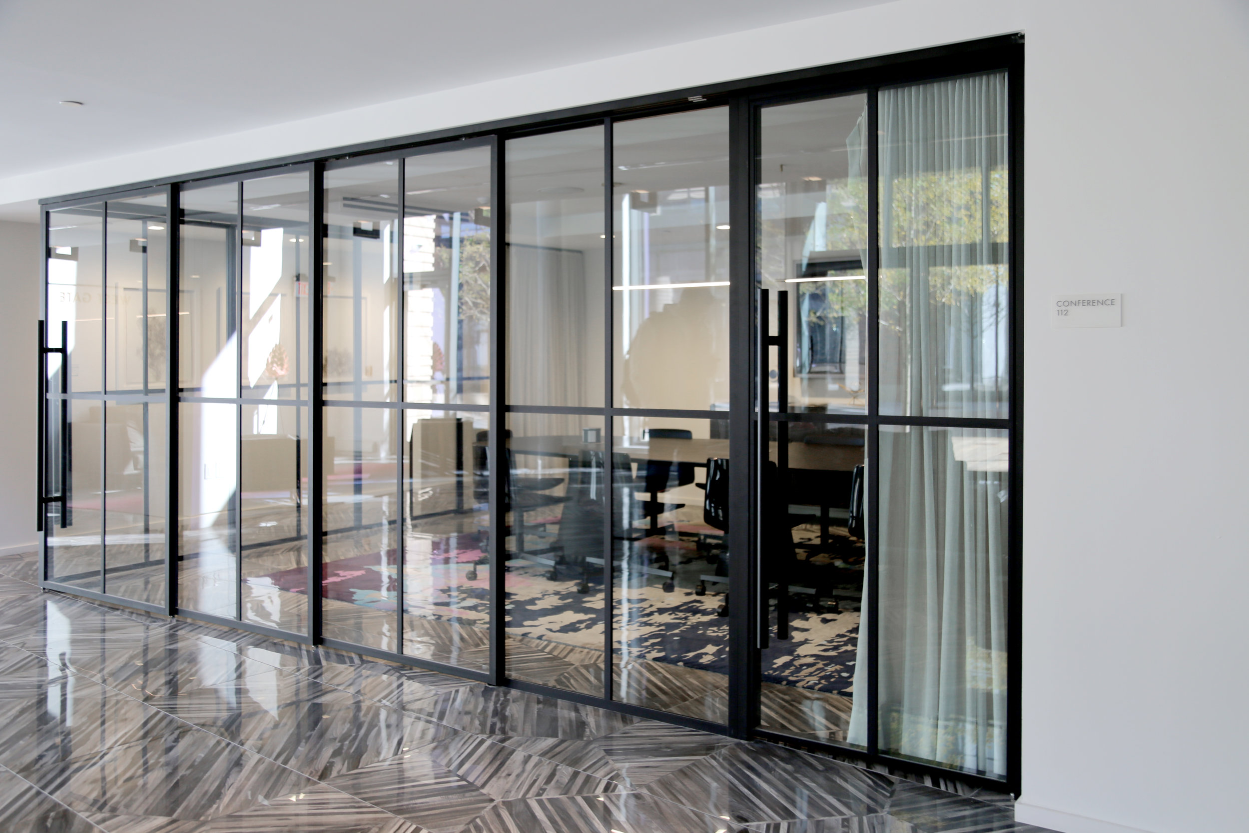 Narrow Profile Telescoping Conference Glass Wall - Spaceworks AI.jpg