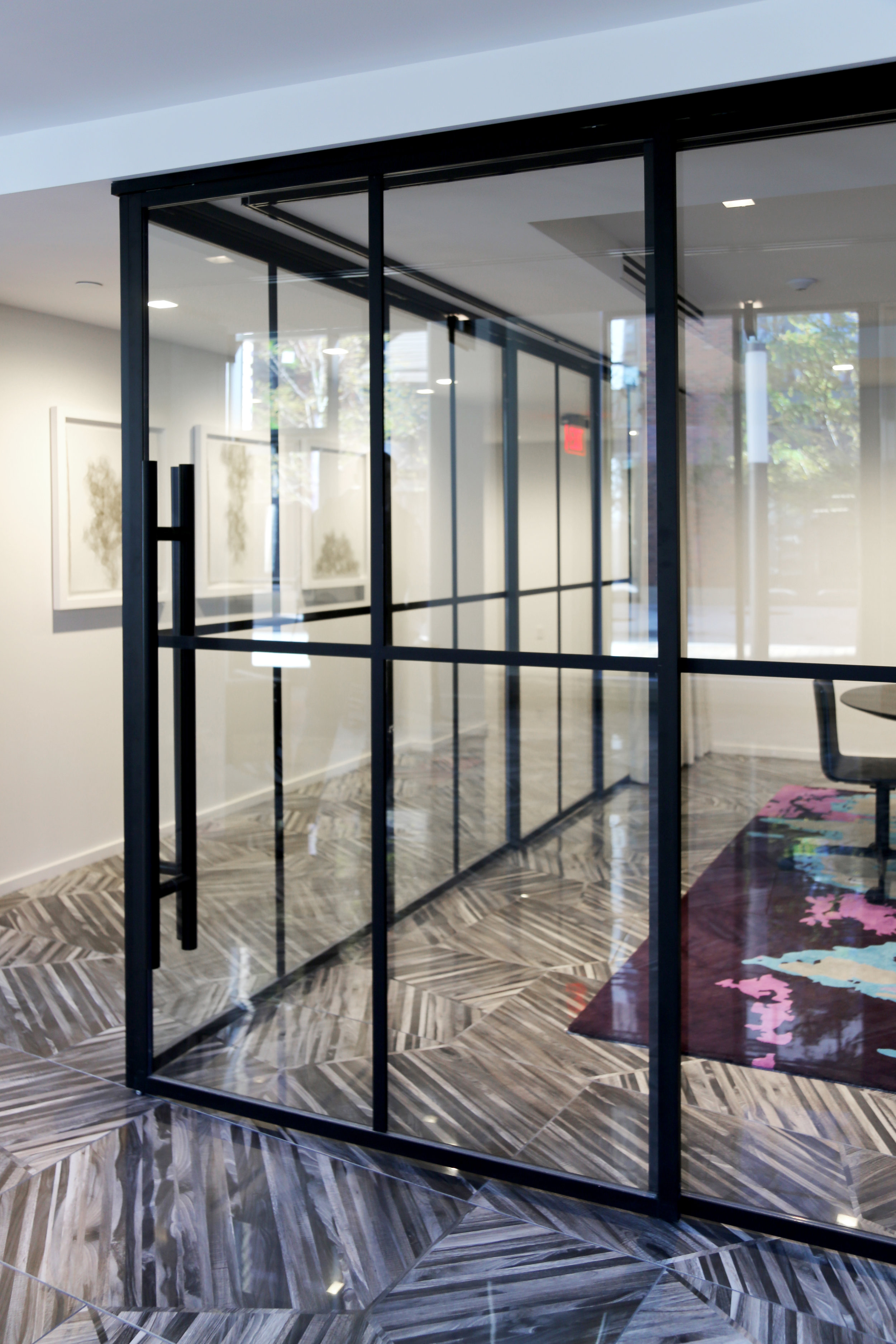 Sliding Stacking Glass Wall System Black Finish Anodized - Spaceworks AI.jpg