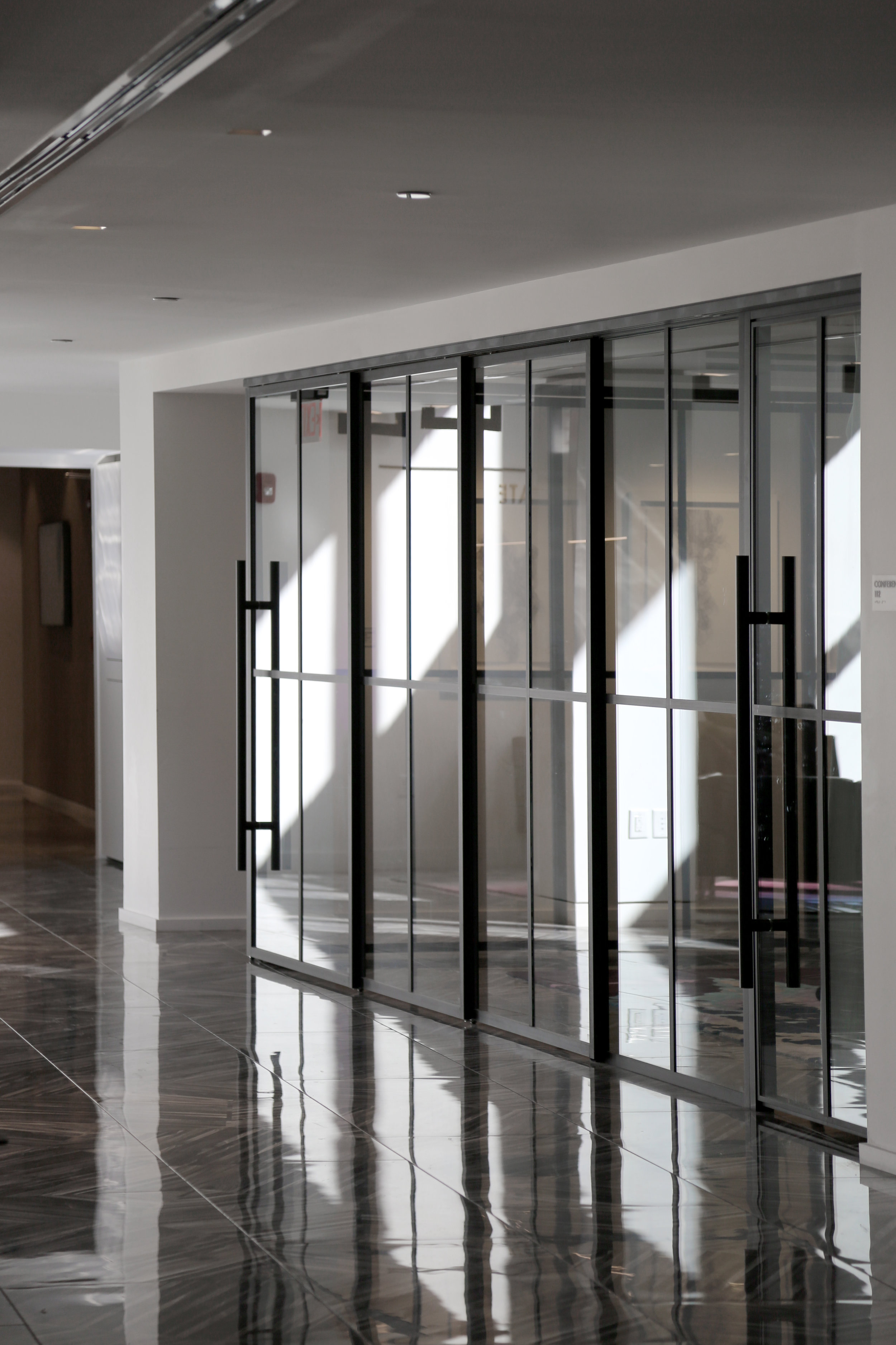 Telescoping Glass Panel Wall System Thin Profile Aluminum-Framed Doors - Spaceworks AI.jpg