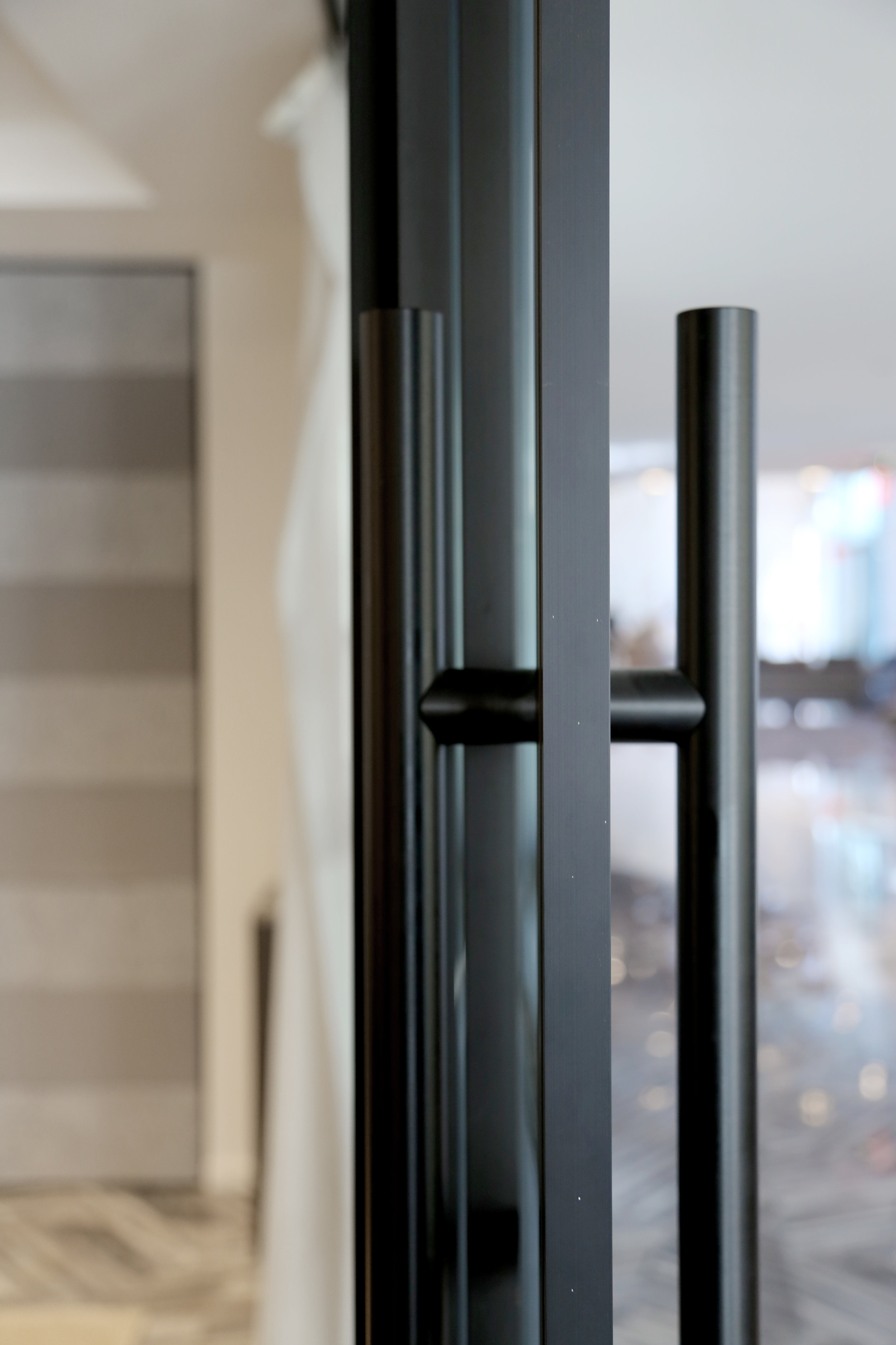 Telescoping Sliding Door Black Anodized Finish Ladder Pull - Spaceworks AI.jpg