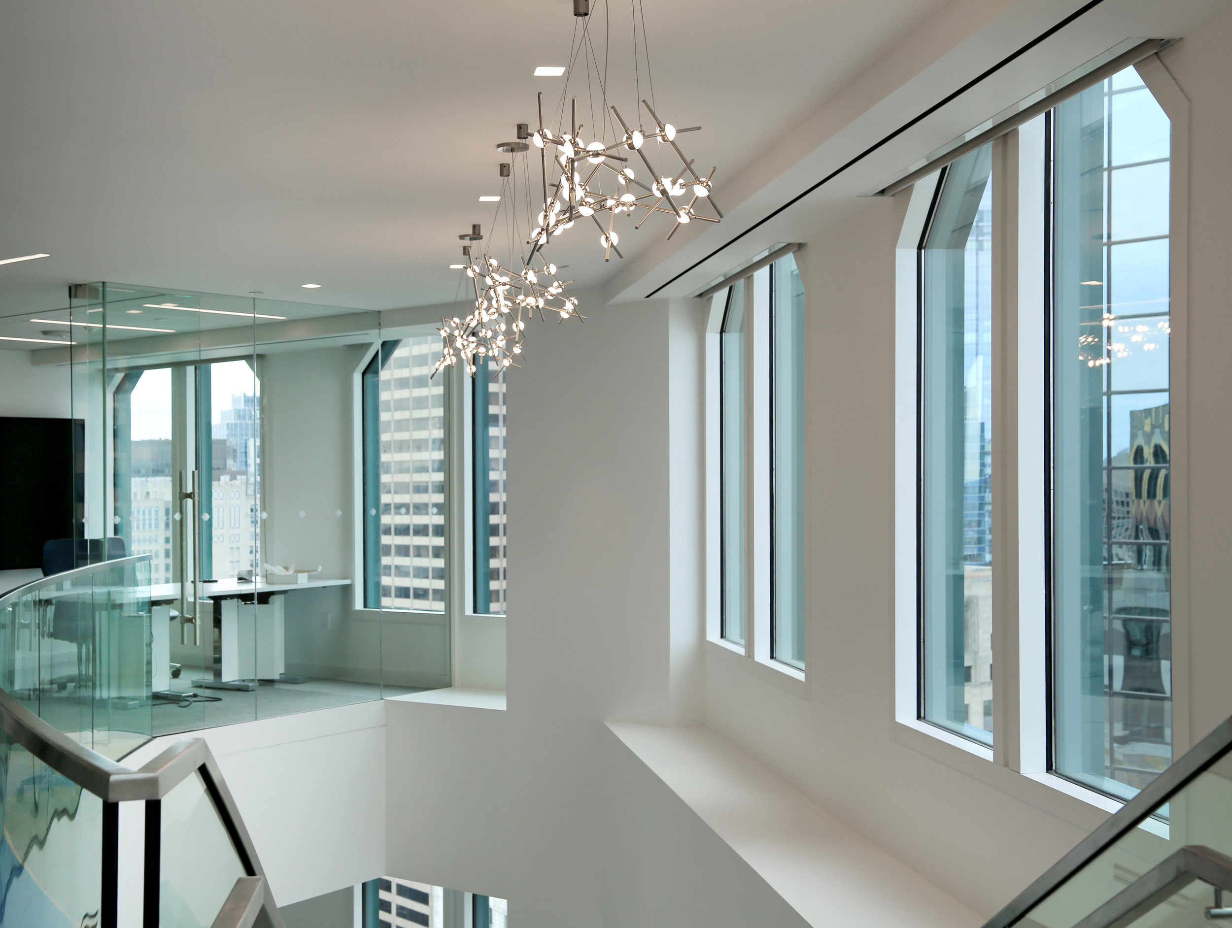 Illume Frameless Glass Conference Room Floating at Staircase - Spaceworks AI.jpg