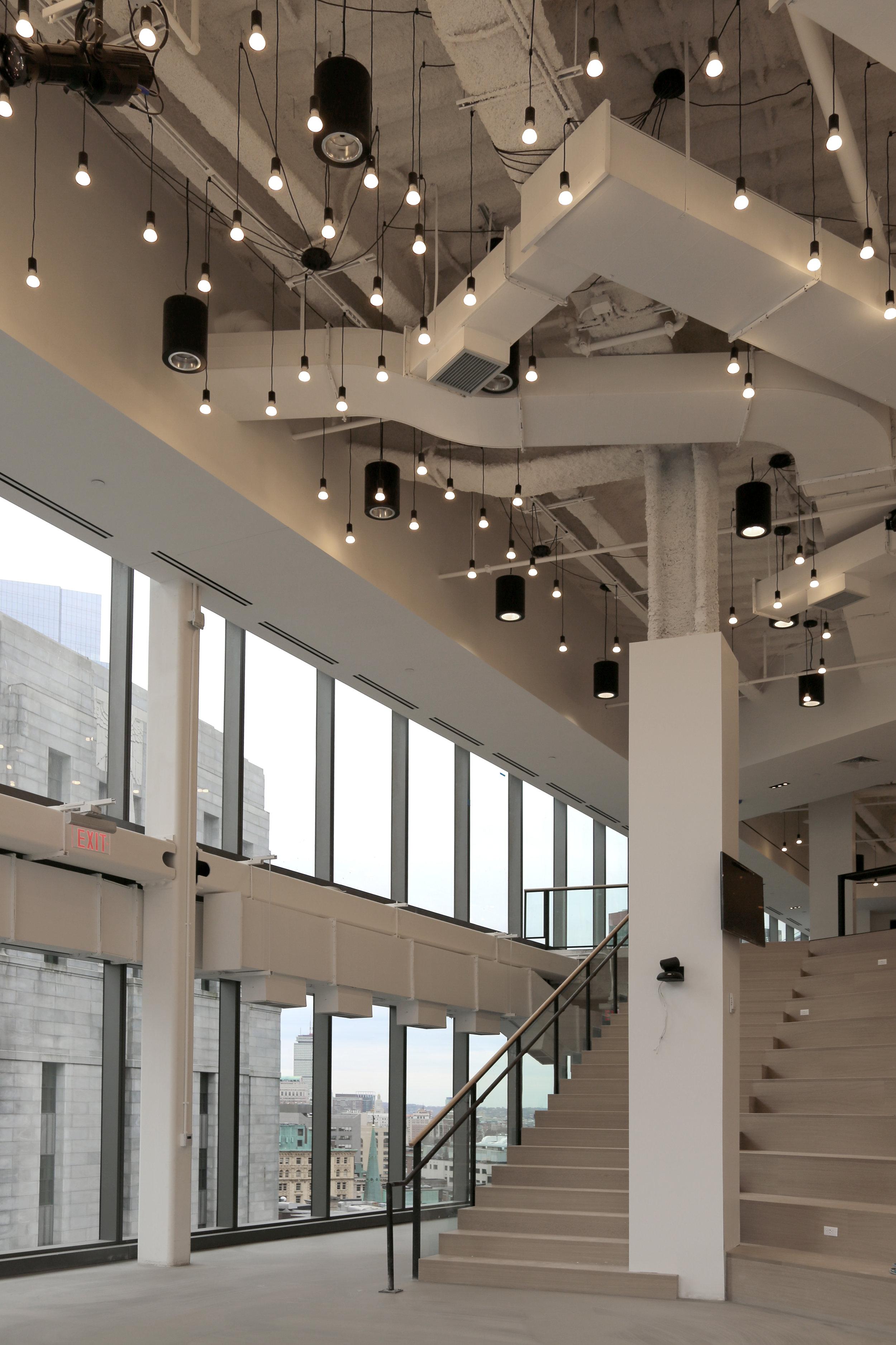 Amphitheater Custom Railing with Black Steel Handrail - Spaceworks AI.jpg