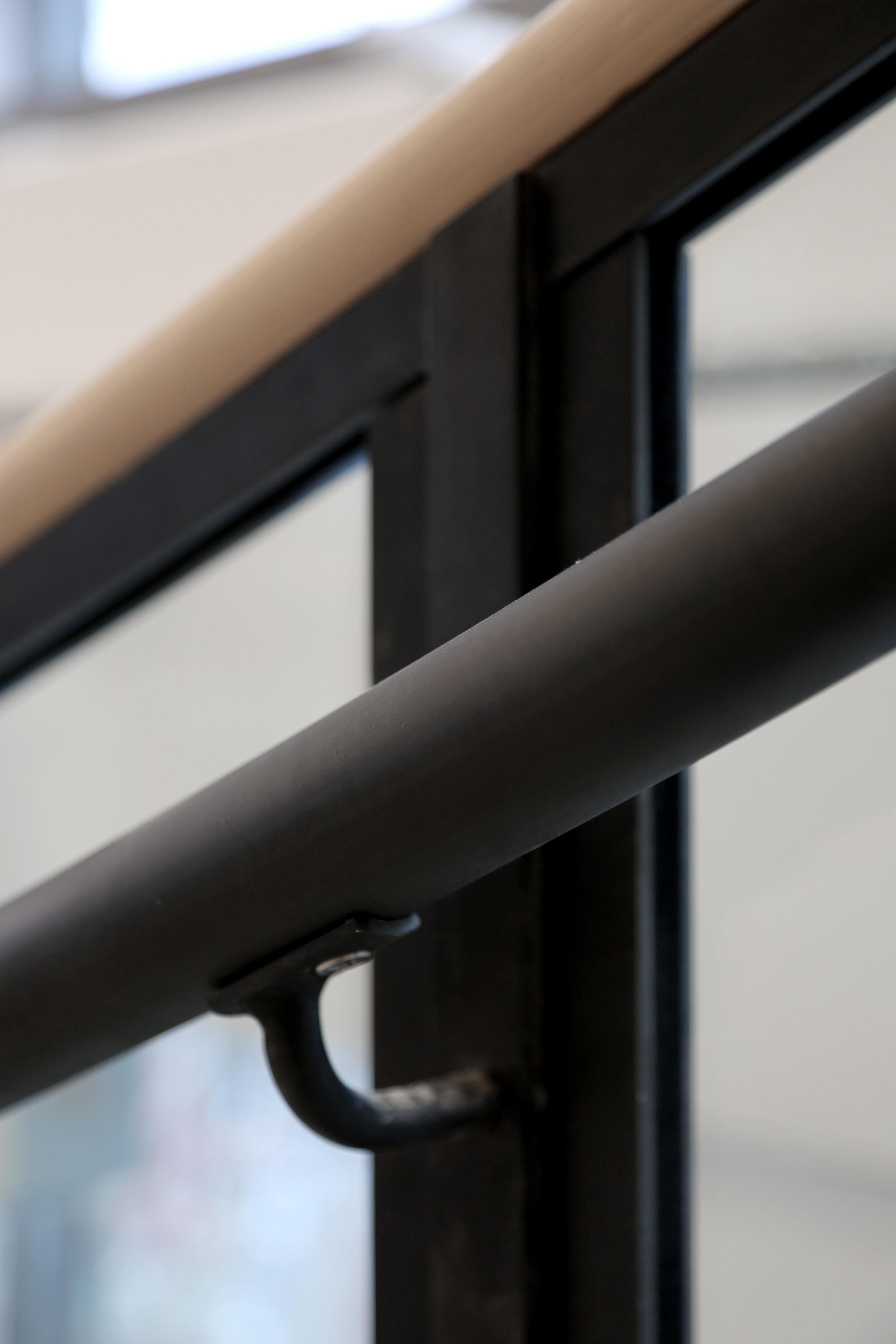 Weathered Black Steel Handrail Glass Staircase Detail - Spaceworks AI.jpg