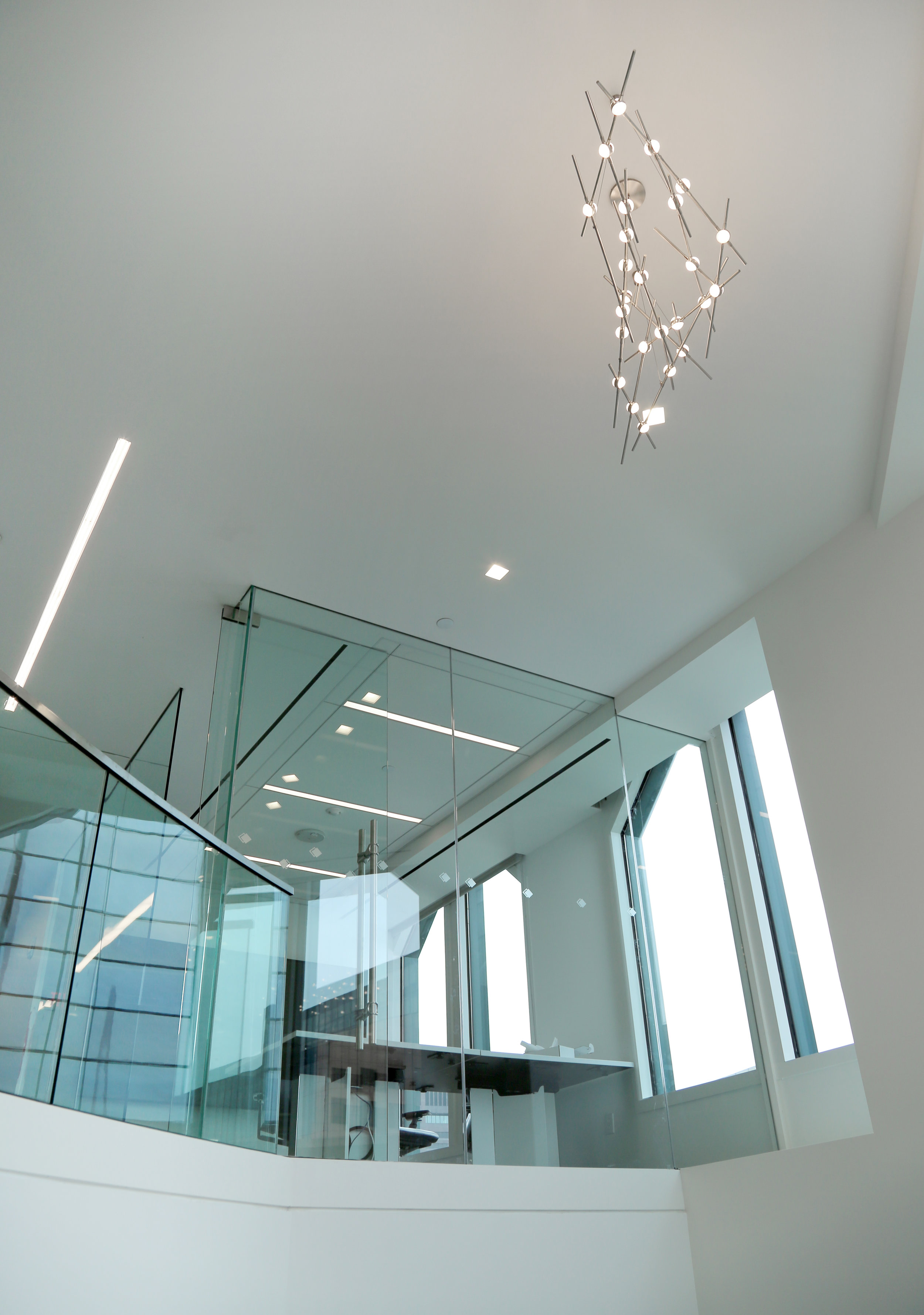 Floating Illume Frameless Conference Wall System at Windows - Spaceworks AI.jpg