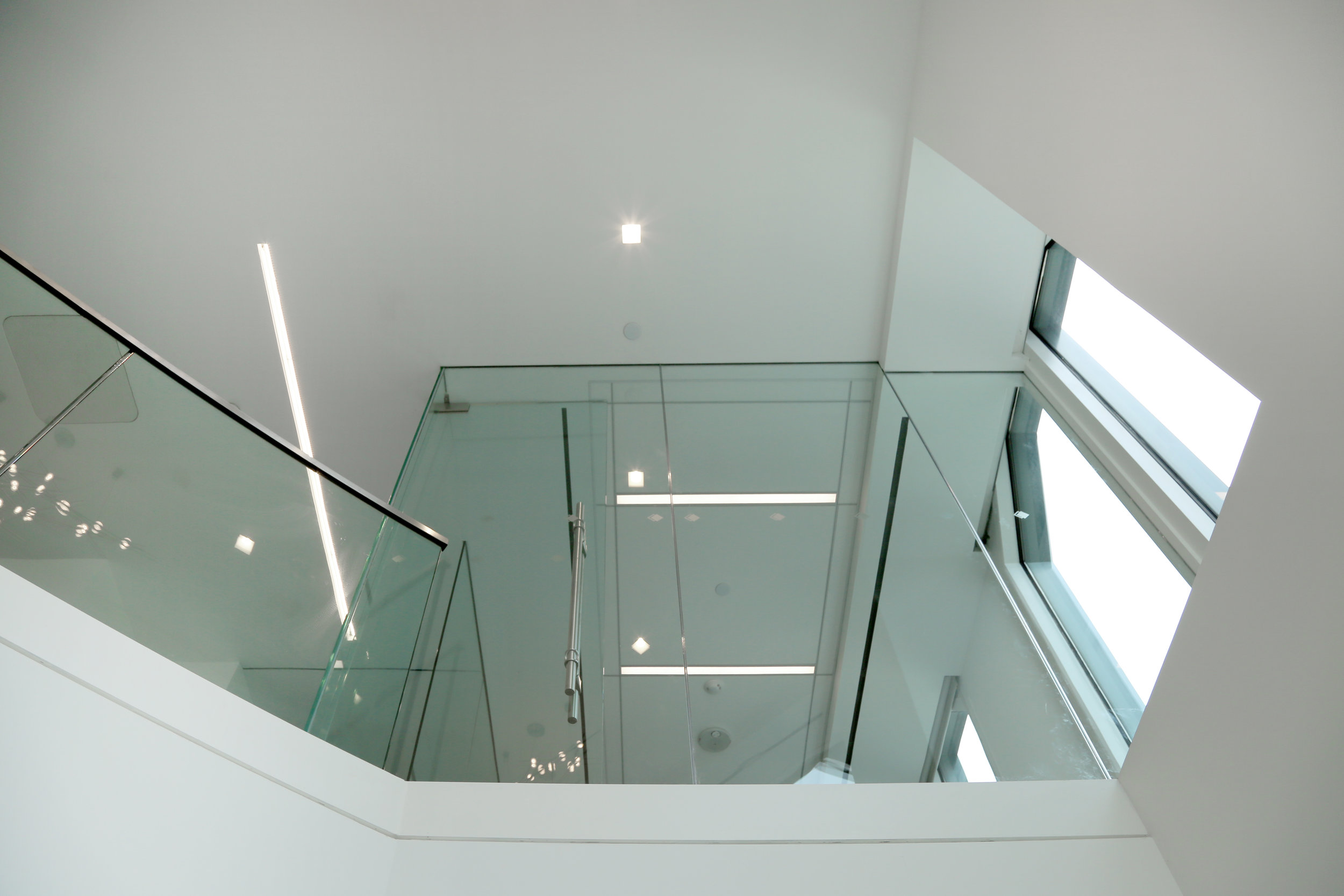Floating Frameless Glass Office Wall Staircase Railing - Spaceworks AI.jpg