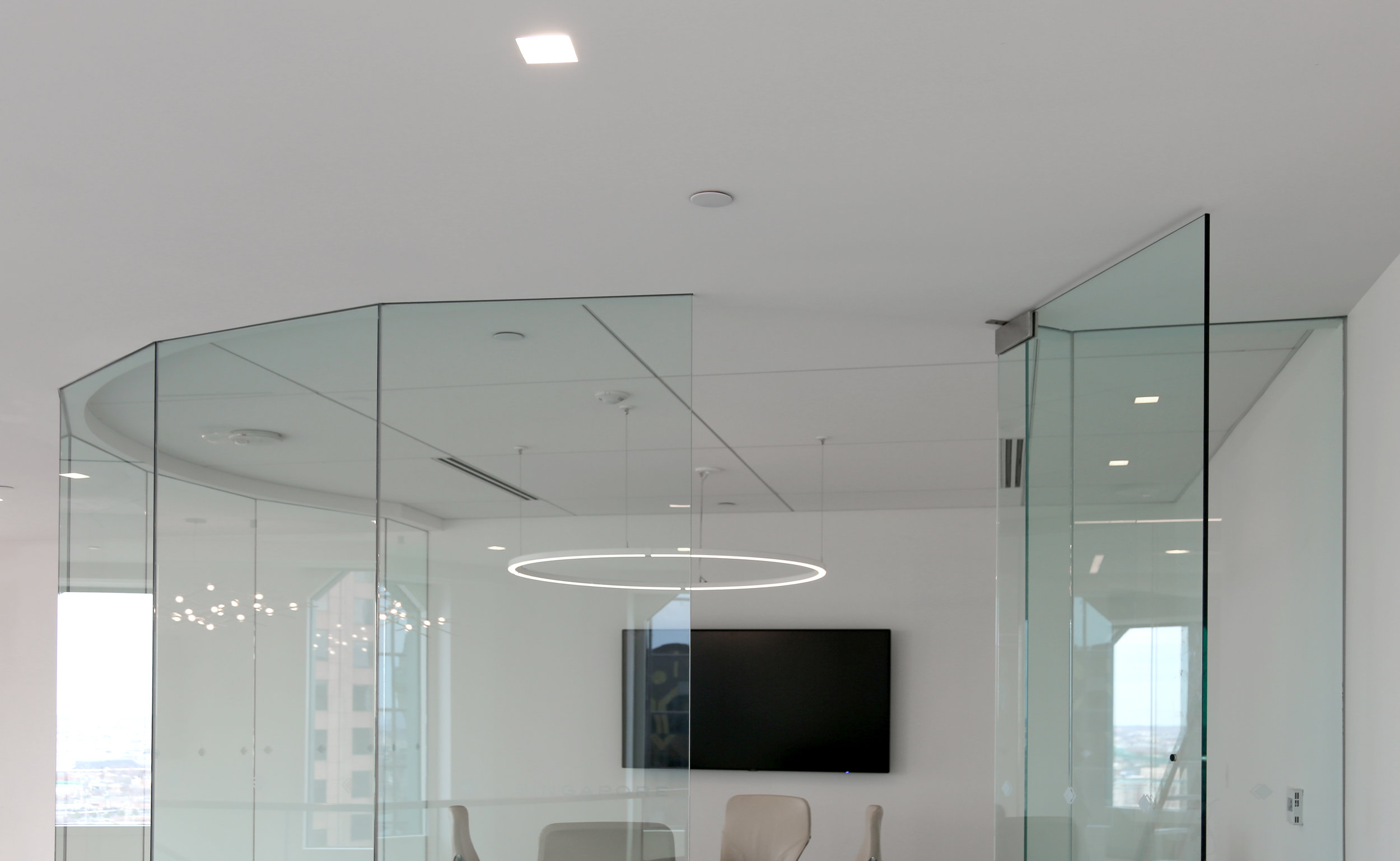 Frameless Glass Circular Faceted Conference Room - Spaceworks AI.jpg