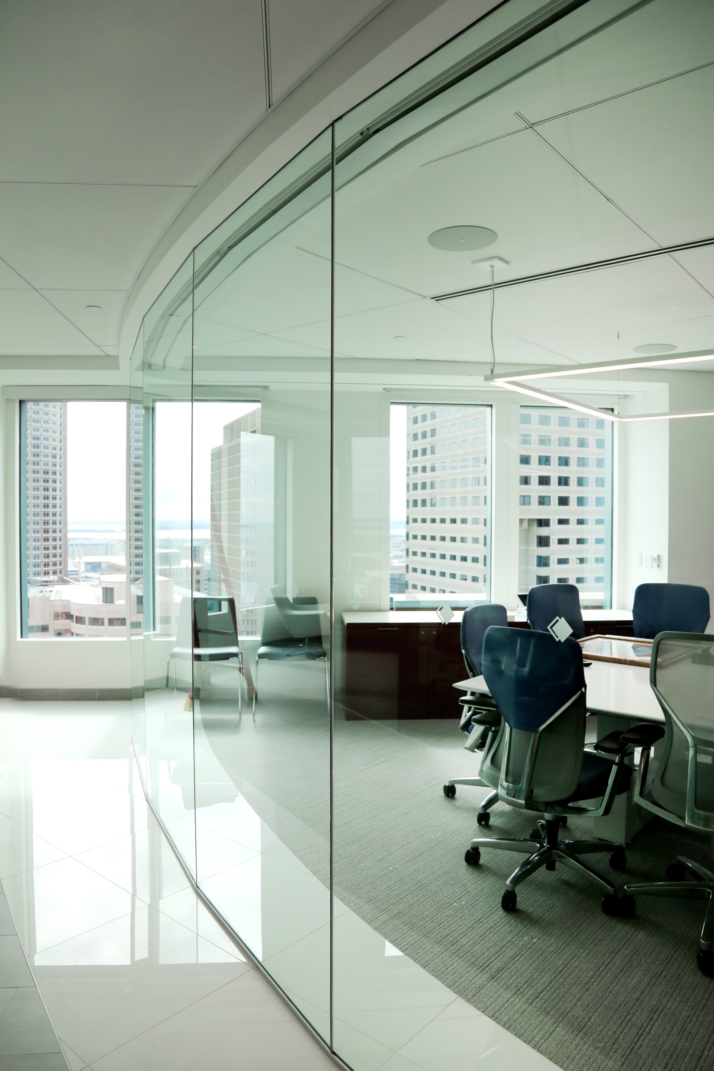 Frameless Glass Curved Faceted Wall Butt-Glazed Glass Joints - Spaceworks AI.jpg