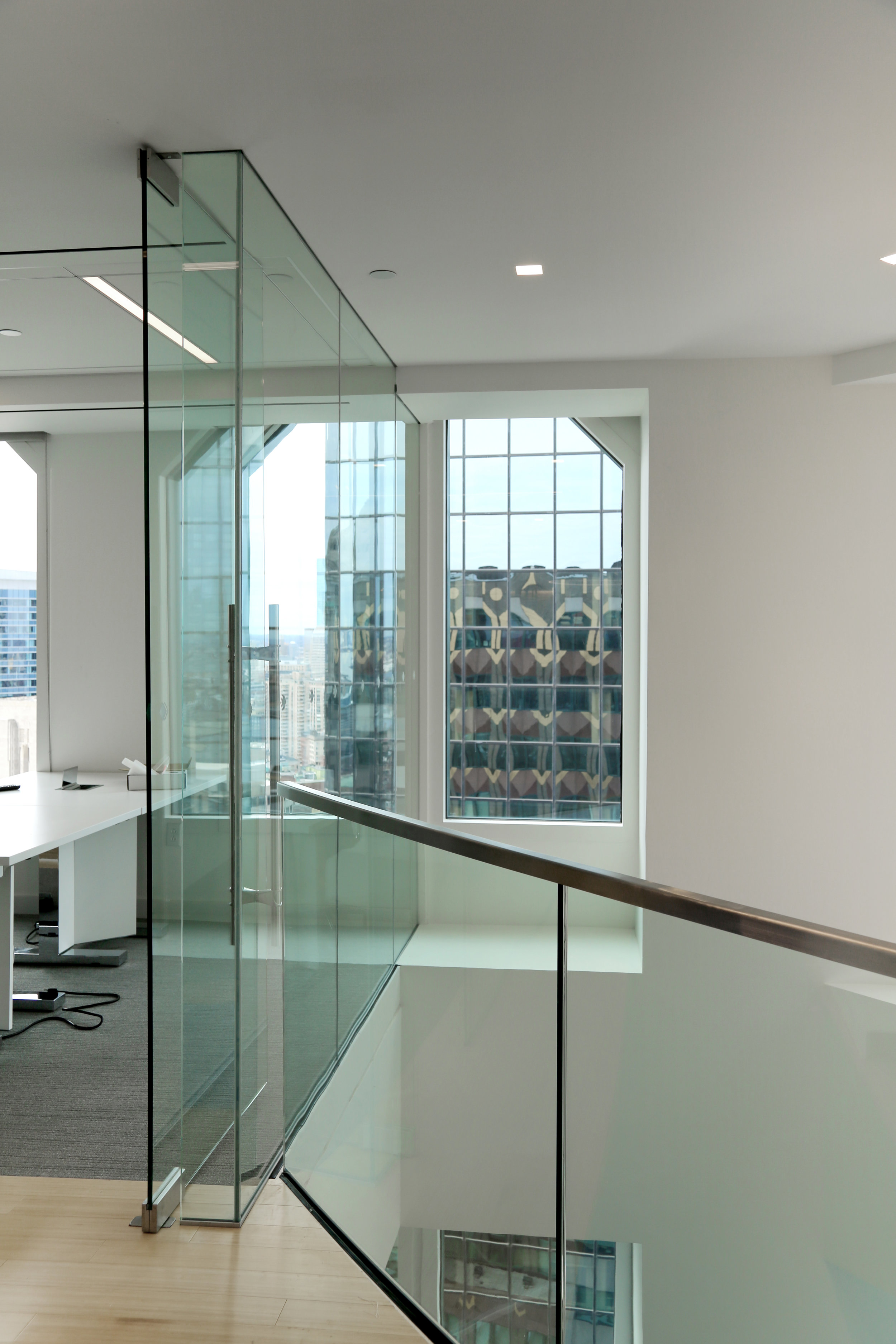 Frameless Glass Door Wall System Corner Edge Condition - Spaceworks AI.jpg